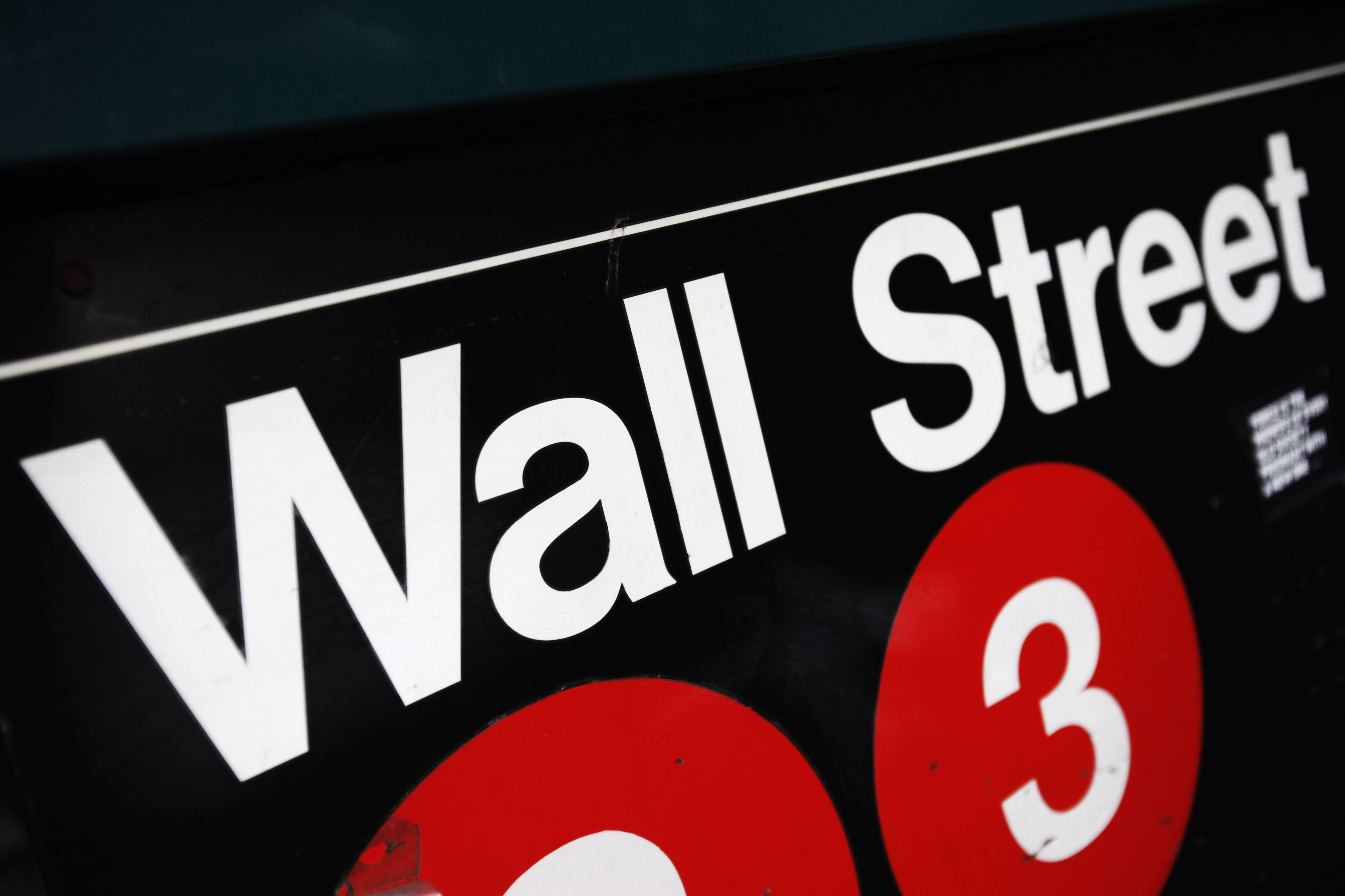 Stocks closed slightly higher Monday as investors turned their focus to corporate news and as tensions eased in Ukraine.