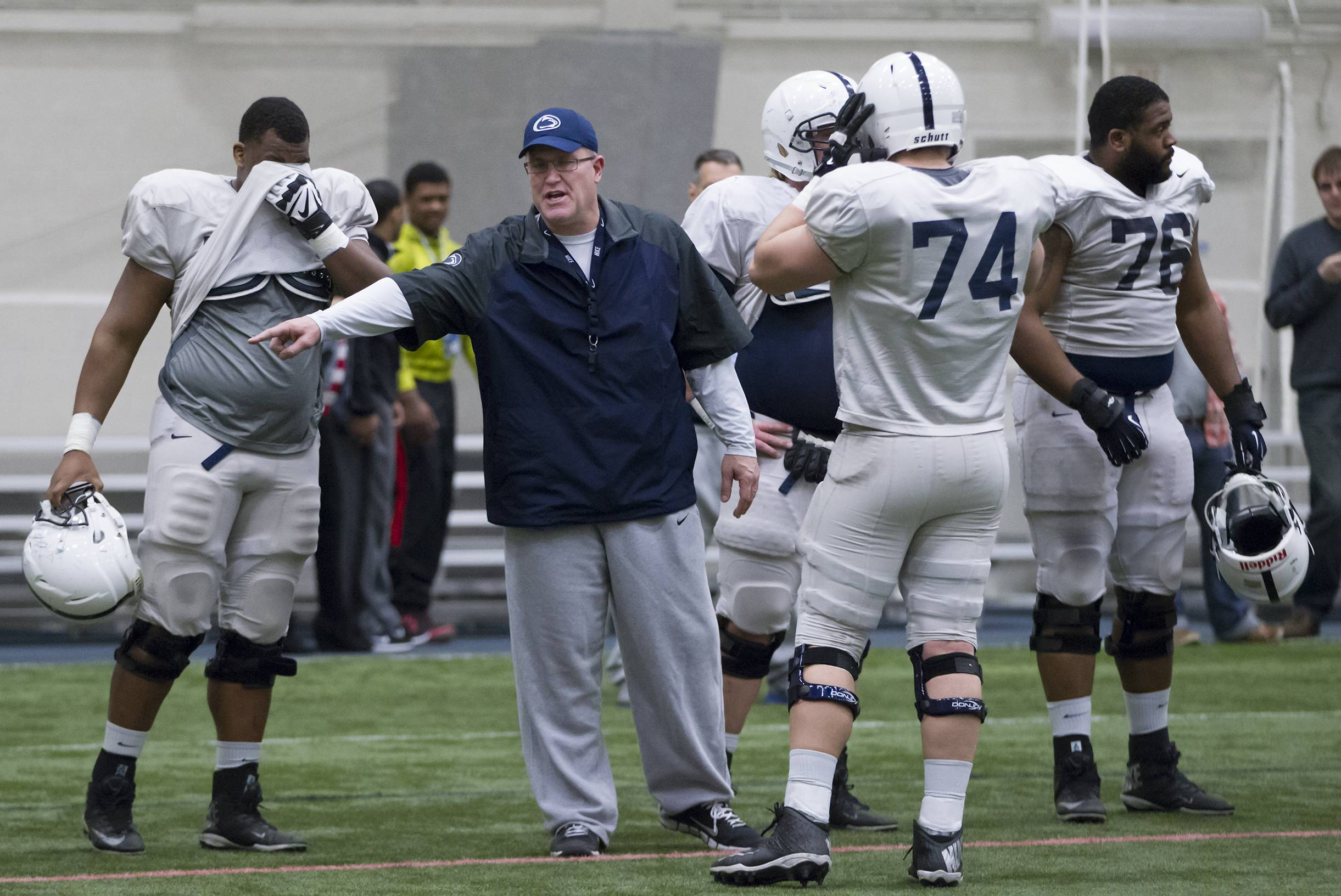 "Penn State offensive line coach Herb Hand motions to players during a team practice in State College, Pa. Hand, who took to Twitter recently to vent his frustration with a recruit gone bad online. ""Dropped another prospect this AM due to his social media presence ... Actually glad I got to see the 'real' person before we offered him,"" Hand tweeted."