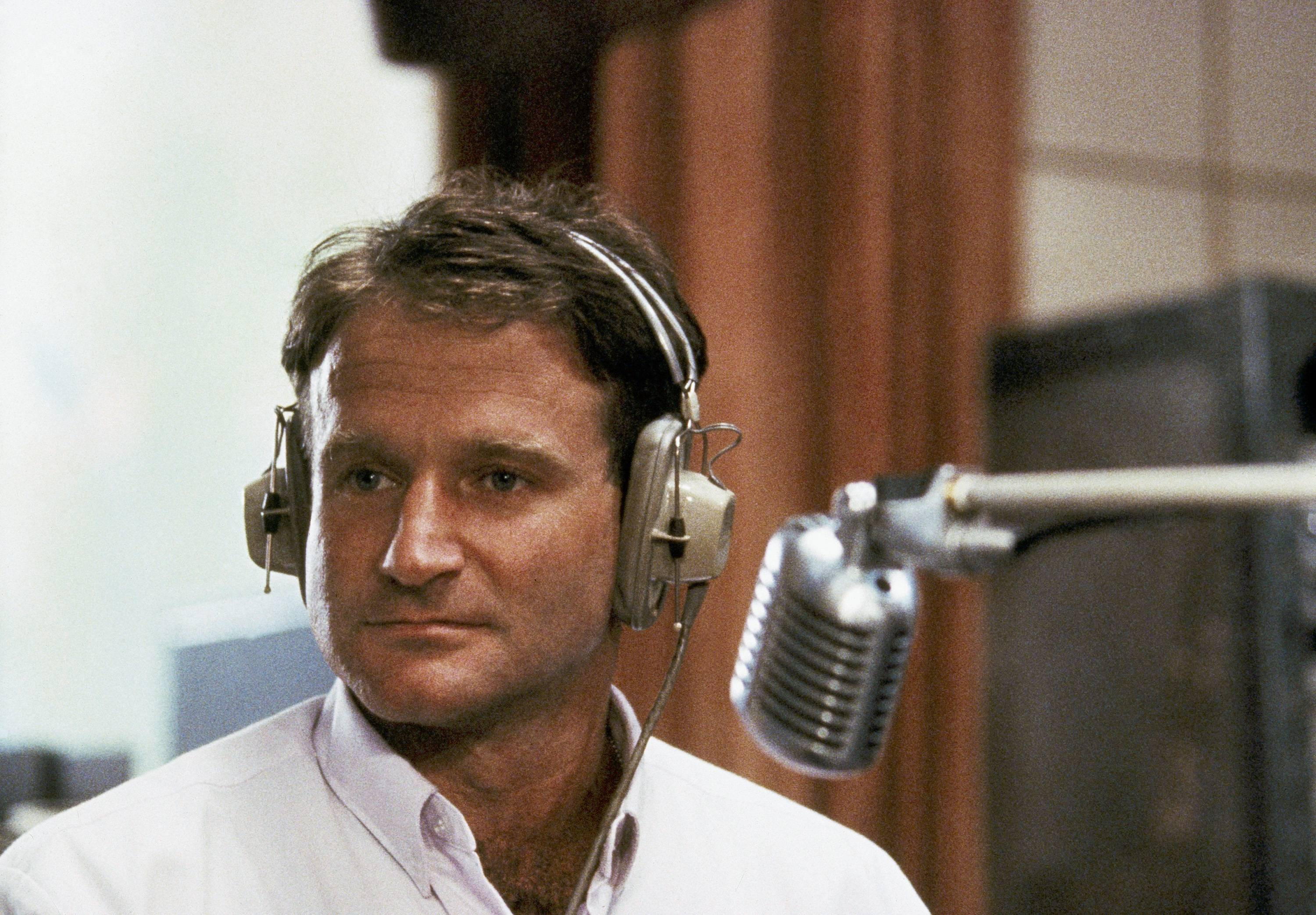 "Robin Williams played disc-jockey Adrian Cronauer in director Barry Levinson's comedy-drama, ""Good Morning Vietnam."" Williams, whose free-form comedy and adept impressions dazzled audiences for decades, has died in an apparent suicide. He was 63."