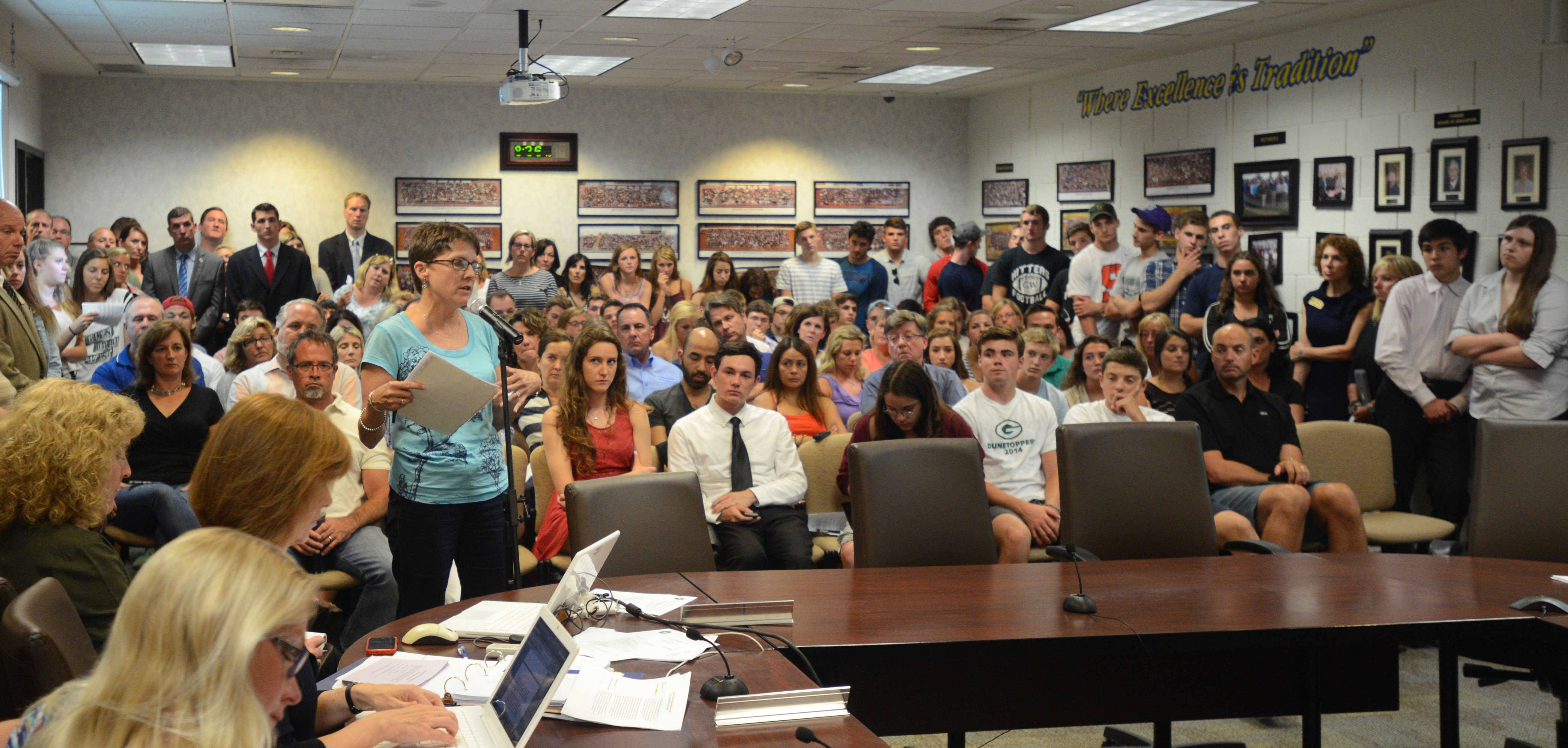 A large crowd listens during the public participation portion of  a school district 87 board meeting at the Robert C. Stevens Administrative Center in Glen Ellyn on Monday night. Members of the public addressed the issue of several students who were recently disciplined under the district's policy on alcohol.