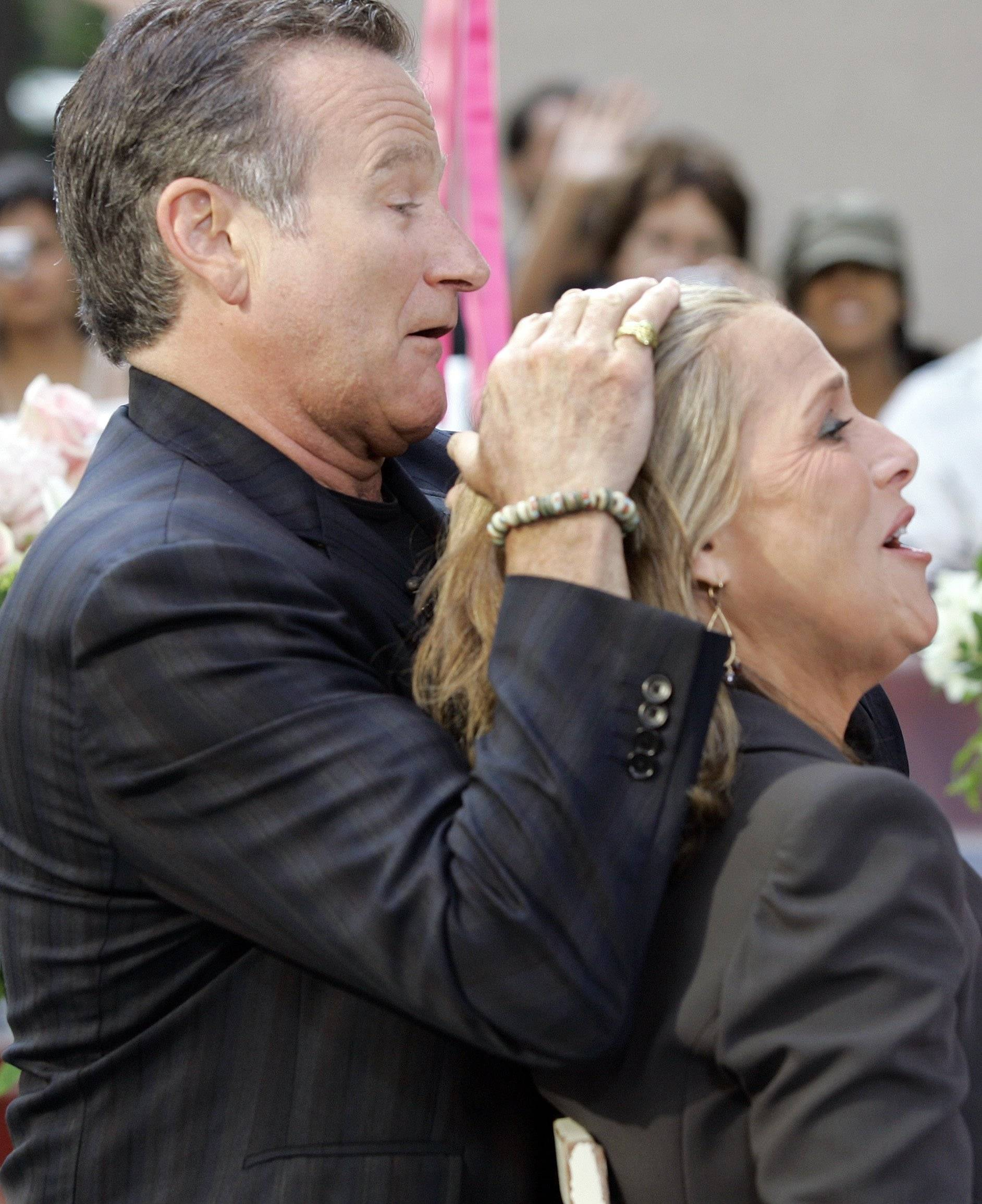 "Actor and comedian Robin Williams pretends to style the hair of NBC ""Today"" television program co-host Meredith Vieira during his interview June 28, 2007, in New York's Rockefeller Center."