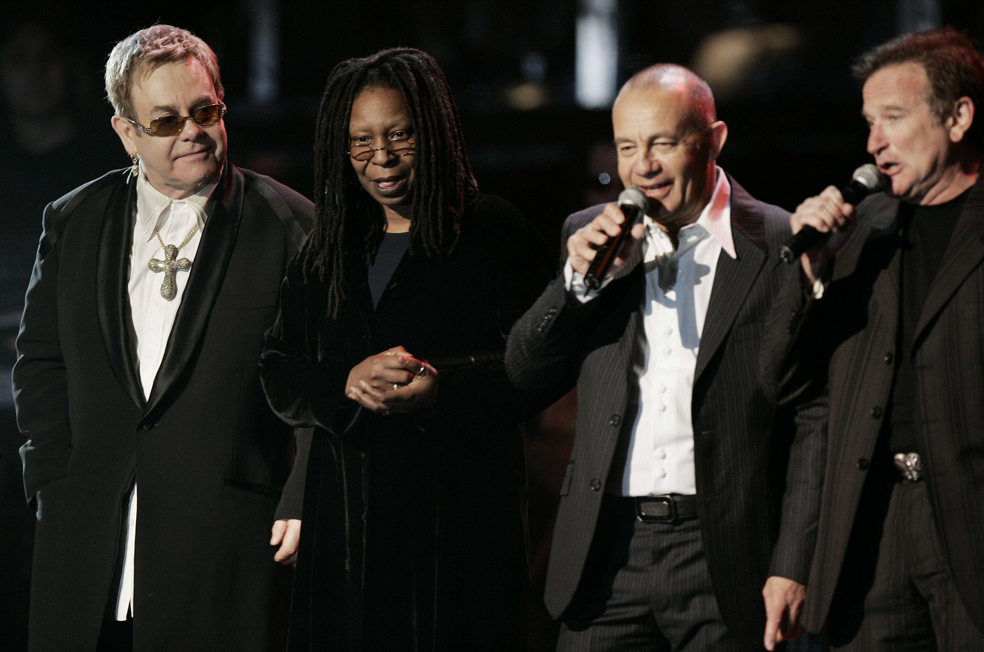 Musician Elton John, left to right, listens as Whoopi Goldberg, song writer Bernie Taupin, and comedian Robin Williams, pay tribute to him on stage March 25, 200 during John's concert in New York's Madison Square Garden,.