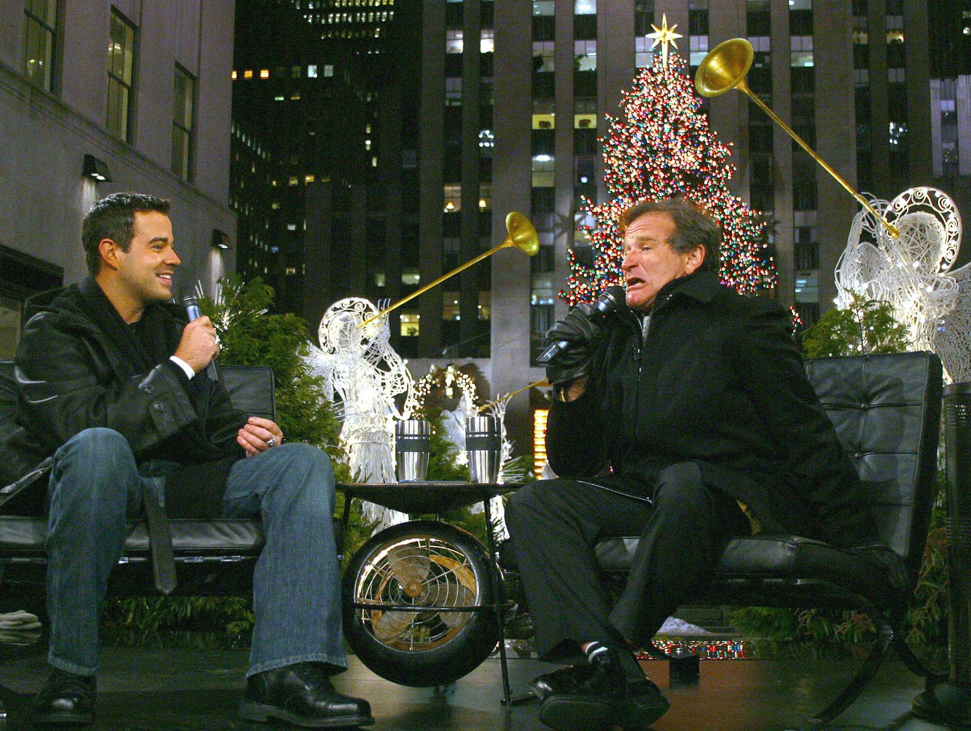 "Talk show host Carson Daly, left, smiles while listening to comedian Robin Williams during the taping of ""Last Call with Carson Daly"" outside on New York City's Rockefeller Plaza Dec. 10, 2002."