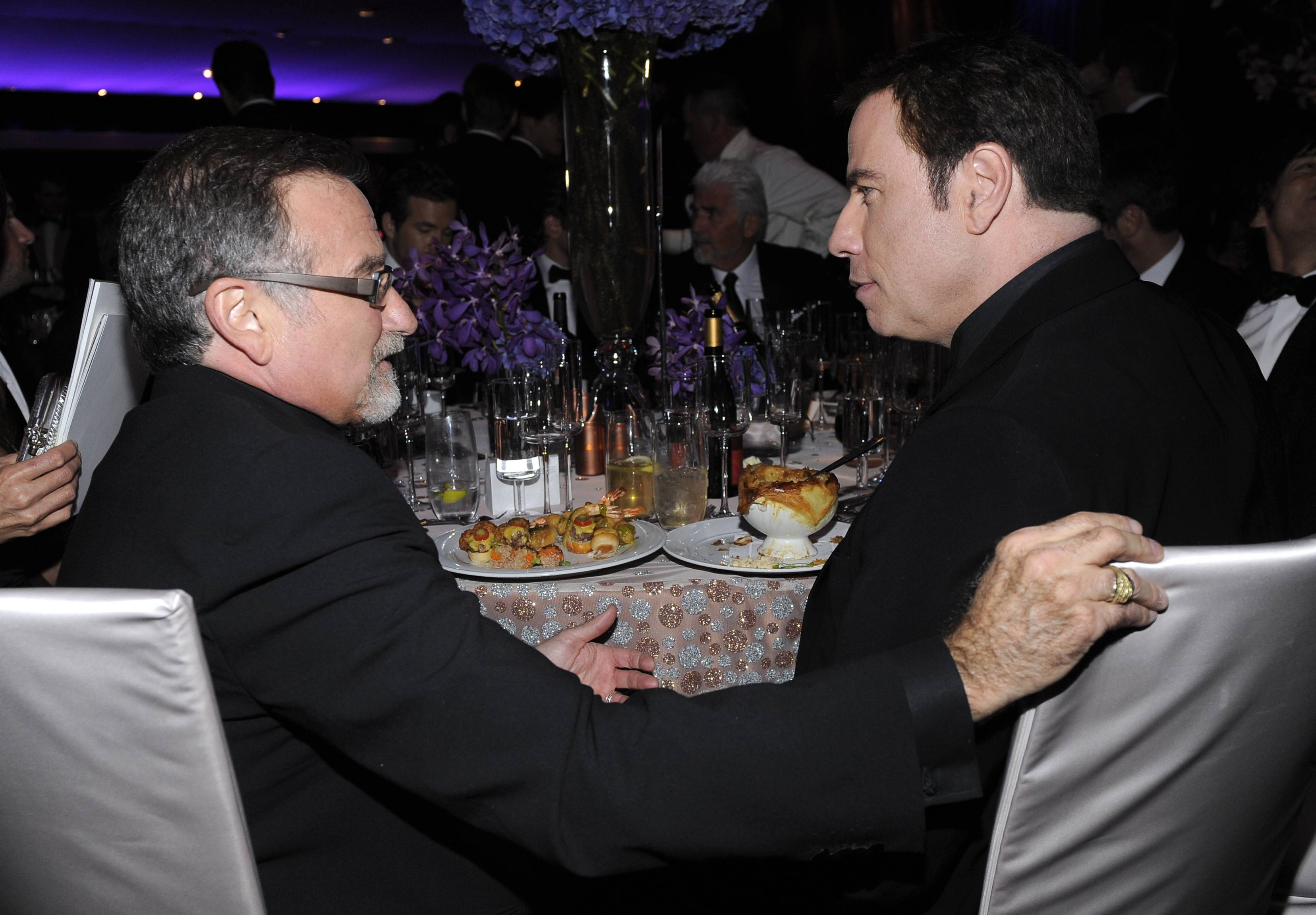Robin Williams, left, and John Travolta at the Governors Ball on March 7, 2010, following the the 82nd Academy Awards.