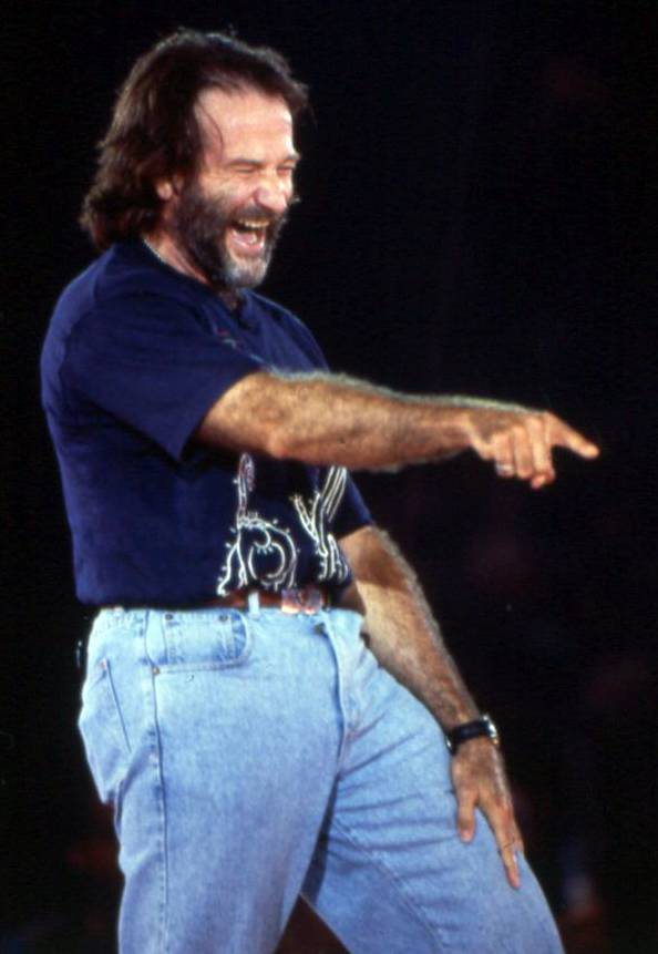 Robin Williams performs a bit of stand up during Comic Relief, a fundraiser which he started with Billy Crystal and Whopping Goldberg.