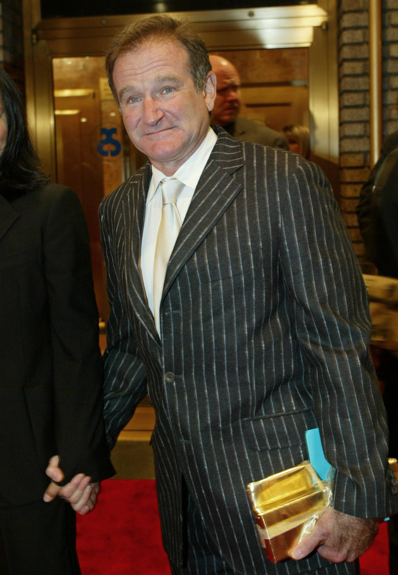 Robin Williams arrives at the Broadhurst Theater in Times Square for the opening of Billy Crystal's new show titled 700 Sundays, New York, in this, Dec. 5, 2004, file photo.