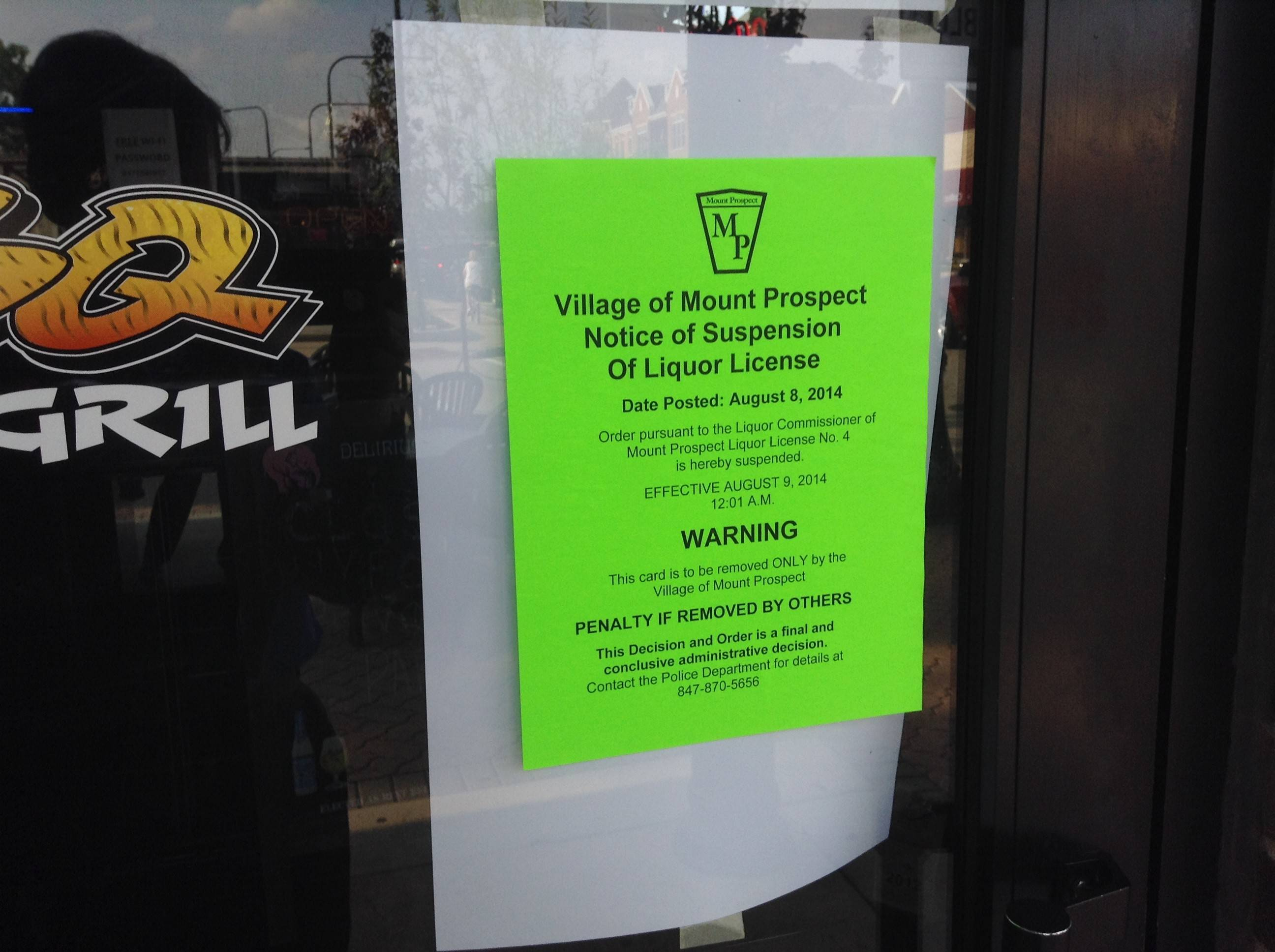 A notice of the suspension of Blues Bar's village liquor license was posted on the door of the Mount Prospect business Monday.
