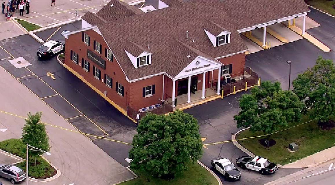 A man shot and injured a bank teller during a robbery early this afternoon at First Midwest Bank in Bolingbrook.