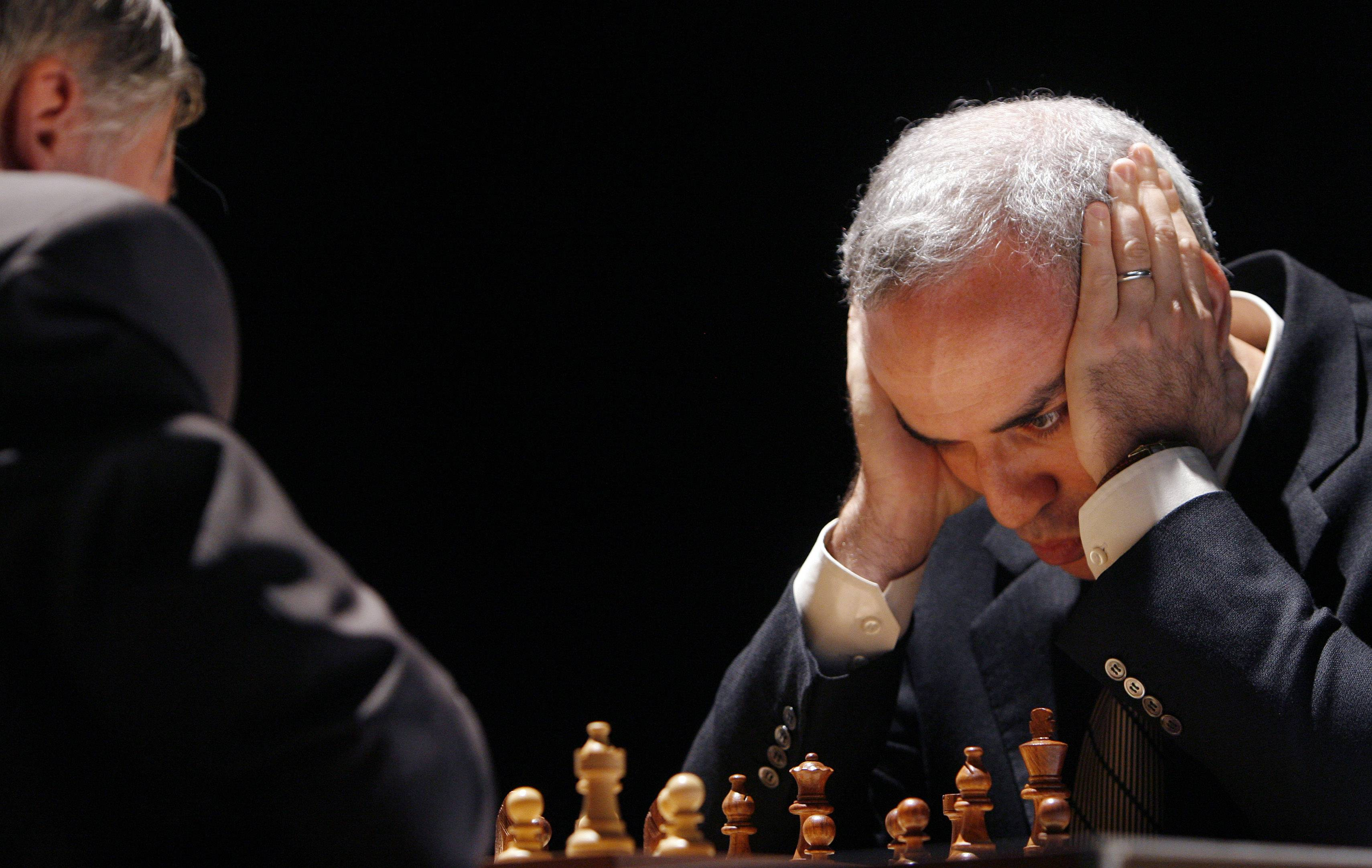 In this Tuesday, 2009 photo, former chess world champion Garry Kasparov, right, and Anatoly Karpov, left, play an exhibition rematch in Valencia, Spain.