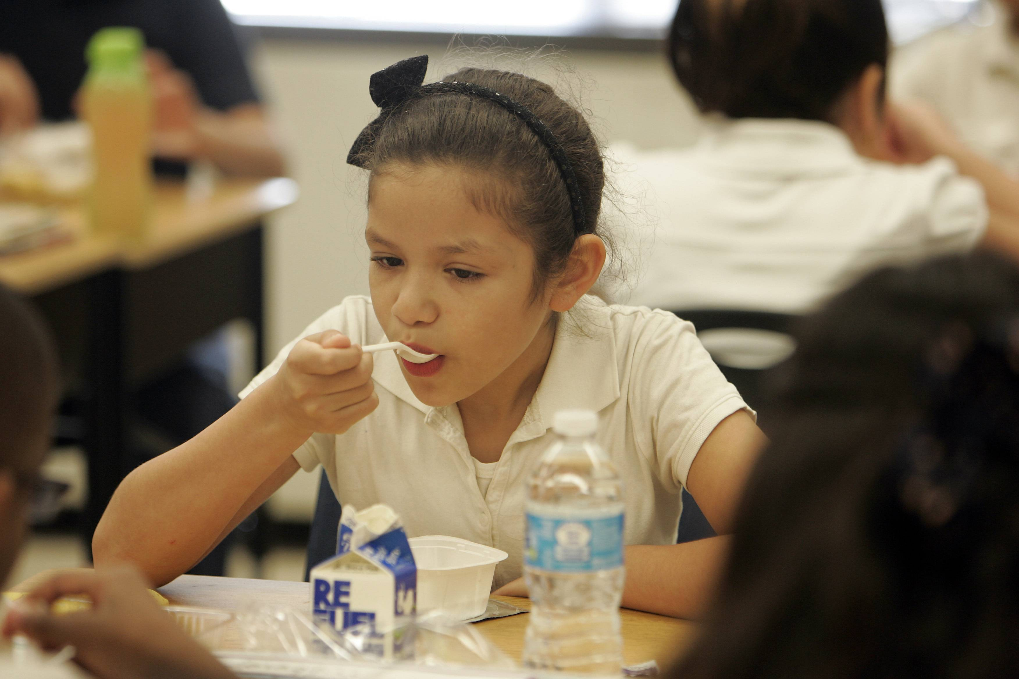 Ten-year-old Delilah Herrera, a fourth-grade student at Harriet Gifford Elementary School in Elgin enjoys breakfast as part of the Breakfast in Classroom program that is available at 10 U46 schools this year. Elgin Area School District U-46 teachers are trying to revive a special program that fed students a free breakfast in their classrooms.