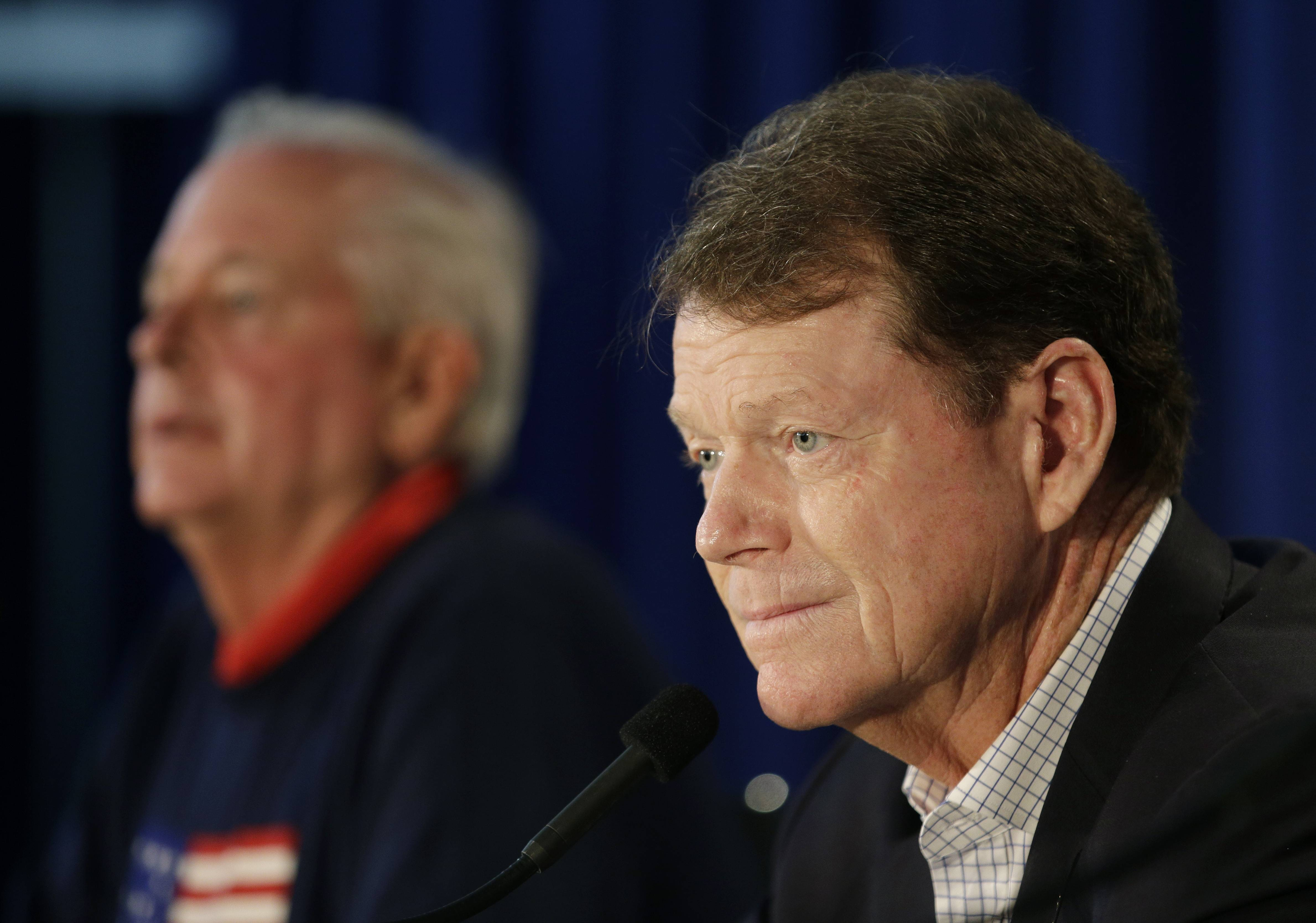 US Ryder Cup Captain Tom Watson, right, speaks at a news conference Monday at Valhalla Golf Club in Louisville, Ky. At left is PGA of America president Ted Bishop. Watson said he won't rule out having Woods on the team.