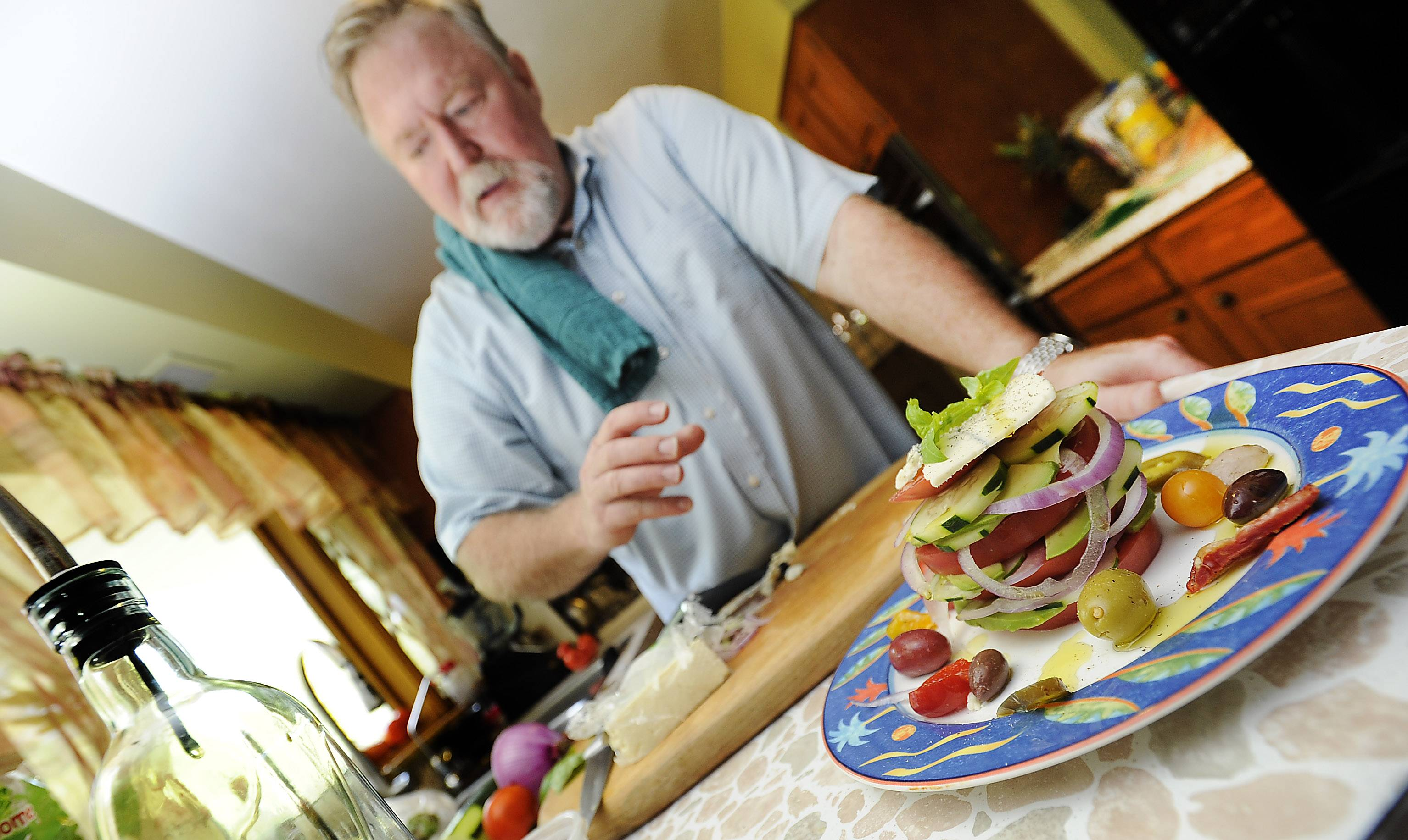 Kevin Kilgore uses tomatoes from his backyard garden for his Fat Stax Tomato Salad.