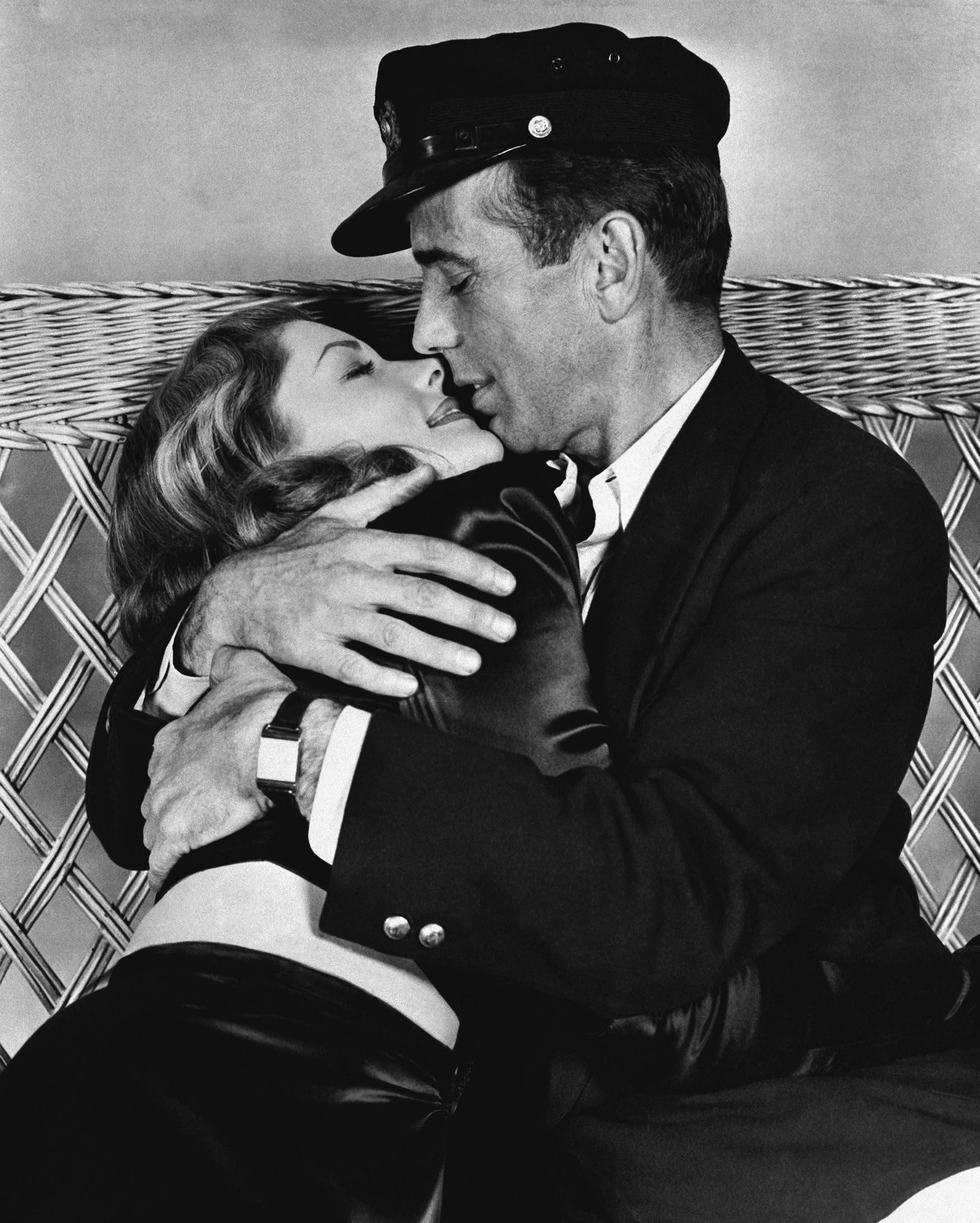 "Actor Humphrey Bogart holds actress Lauren Bacall in a tight embrace in their latest film ""To Have and Have Not."" It was their first appearance on the screen together. The pair went on to marry in 1945."