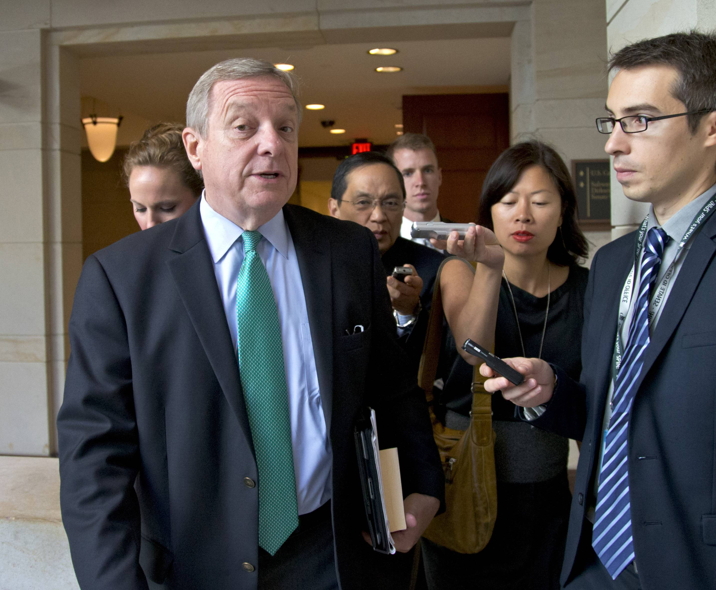 "Sen. Dick Durbin, the No. 2 ranked Democrat who voted against President George W. Bush's Iraq war authorization 12 years ago, said the White House assured him no U.S. boots on the ground were required. ""While this is strictly an air mission, I still have concerns,"" he declared, saying American troops couldn't solve Iraq's underlying problems."