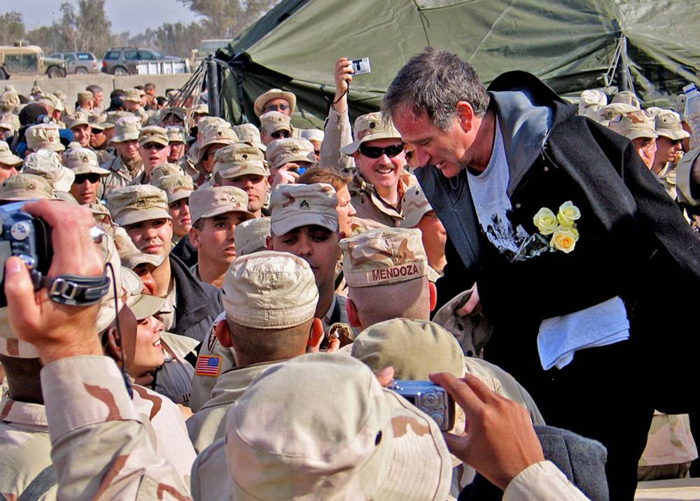 Actor-comedian Robin Williams greets troops during a United Services Organization-sponsored tour at Camp Al Tahreer, in Baghdad, Iraq. Williams never served in the military, but he was a tireless participant in USO shows.