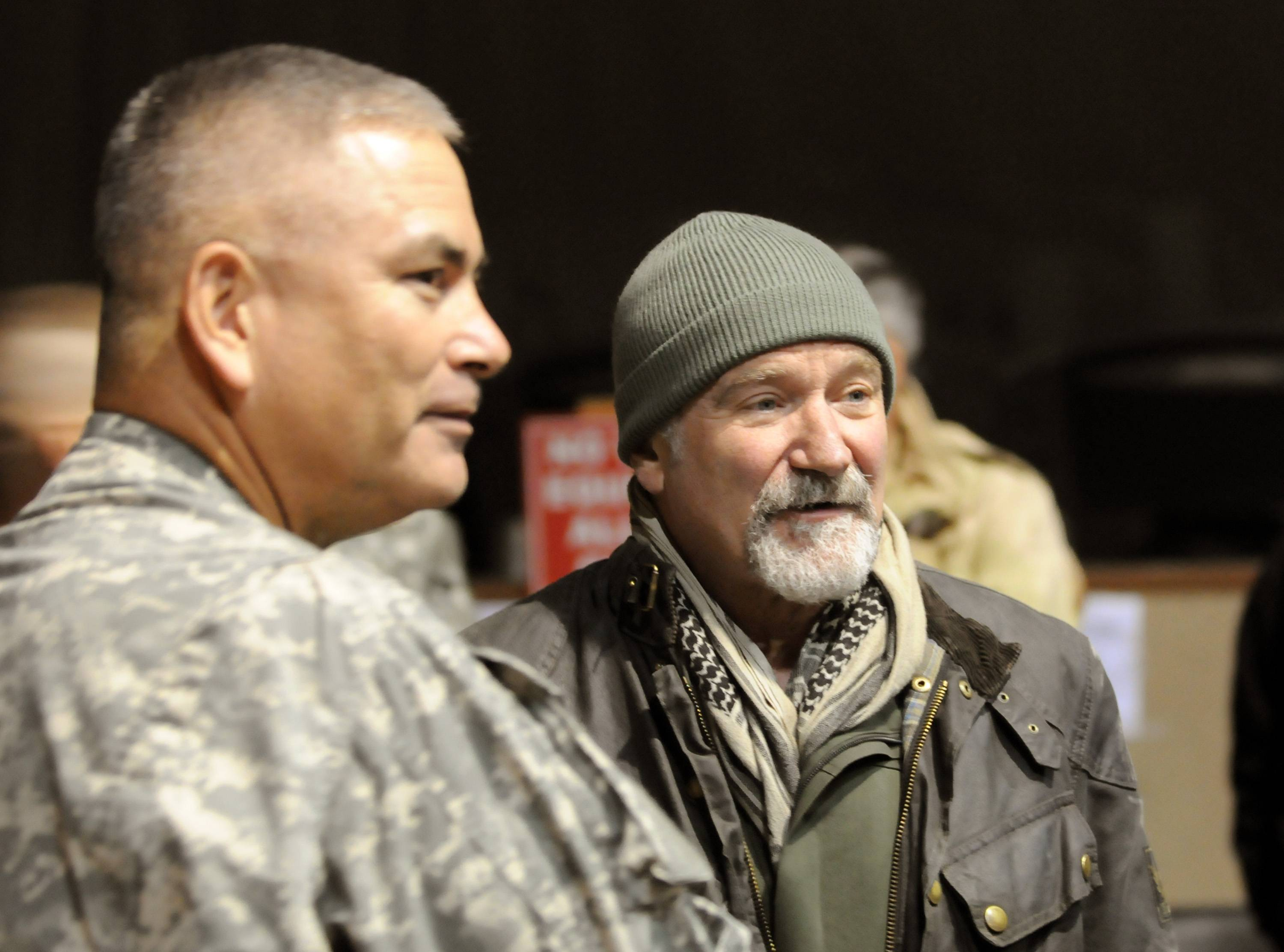 This Dec. 15, 2010 photo released by the U.S. Department of Defense shows actor-comedian Robin Williams, right, with U.S. Army Maj. Gen John F. Campbell, Combined Joint Task Force 101 and Regional Command East commander, before the annual USO Holiday Tour at Bagram Air Field, in Afghanistan.