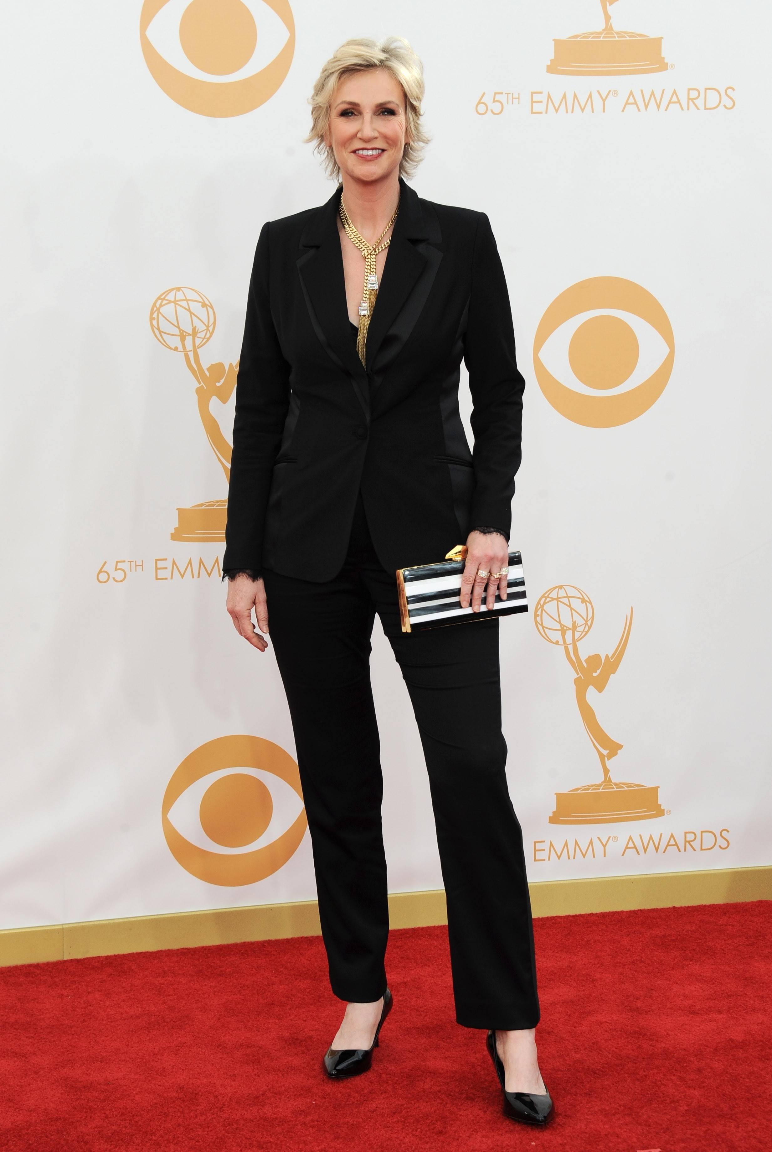 Jane Lynch arrives at the 65th Primetime Emmy Awards at Nokia Theatre on Sunday Sept. 22, 2013, in Los Angeles. (Photo by Jordan Strauss/Invision/AP)