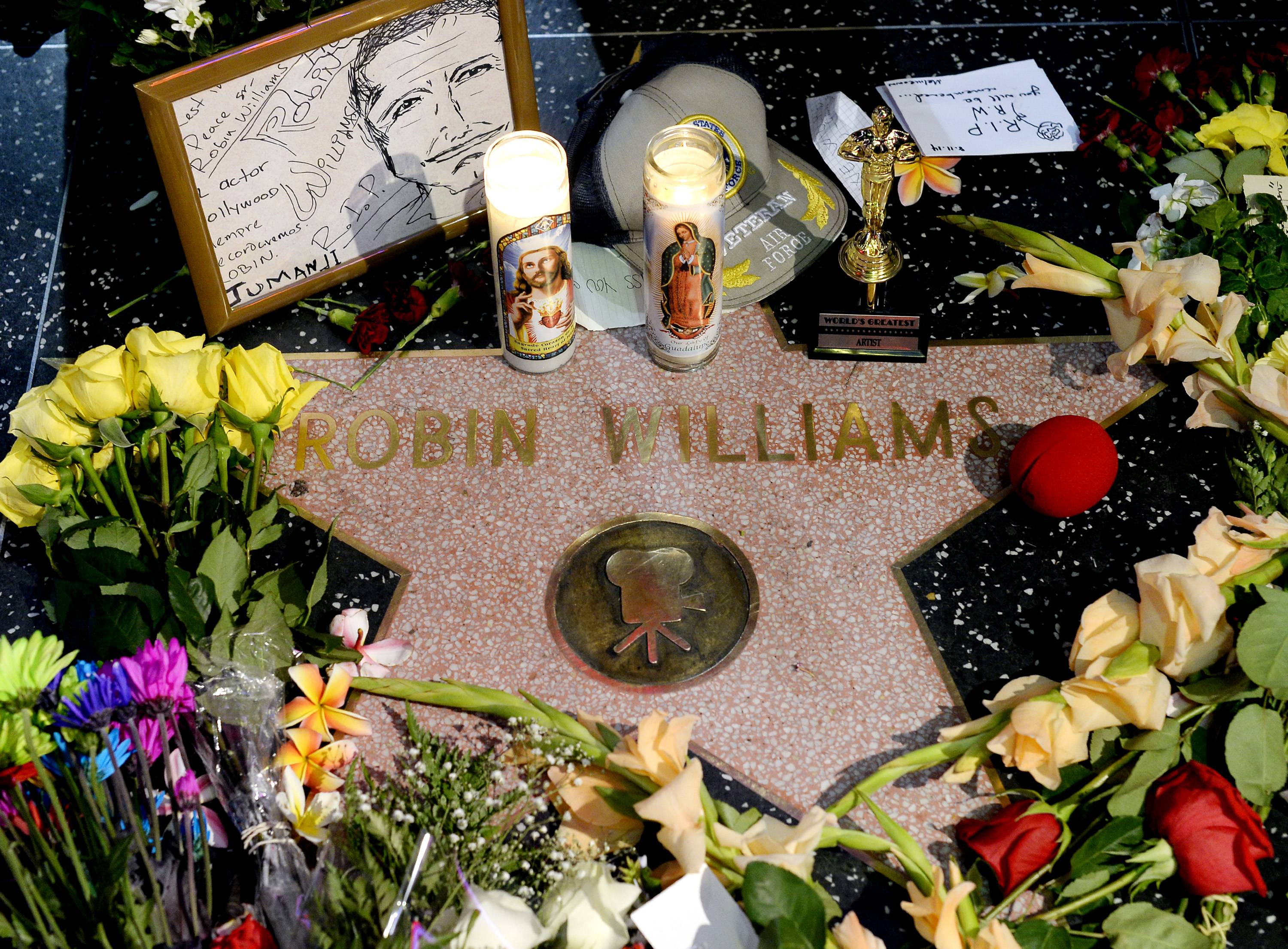 Flowers were placed in memory of actor/comedian Robin Williams on his Walk of Fame star in the Hollywood district of Los Angeles Monday, the day the actor/comedian died in an apparent suicide. He was 63.