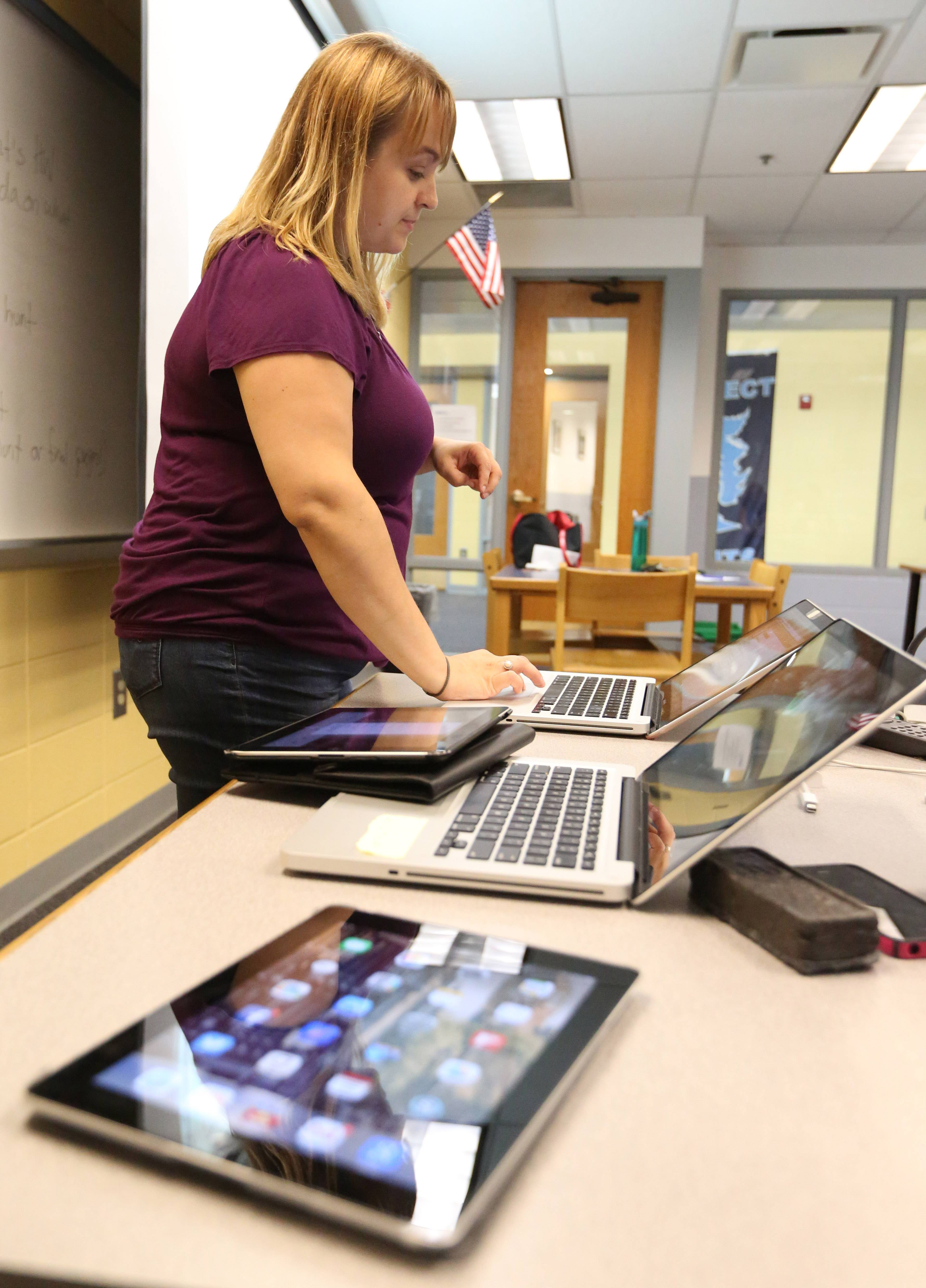 Dist. 214 teacher Persida Bujdei instructs other teachers how to use iPads at Prospect High School in Mount Prospect.