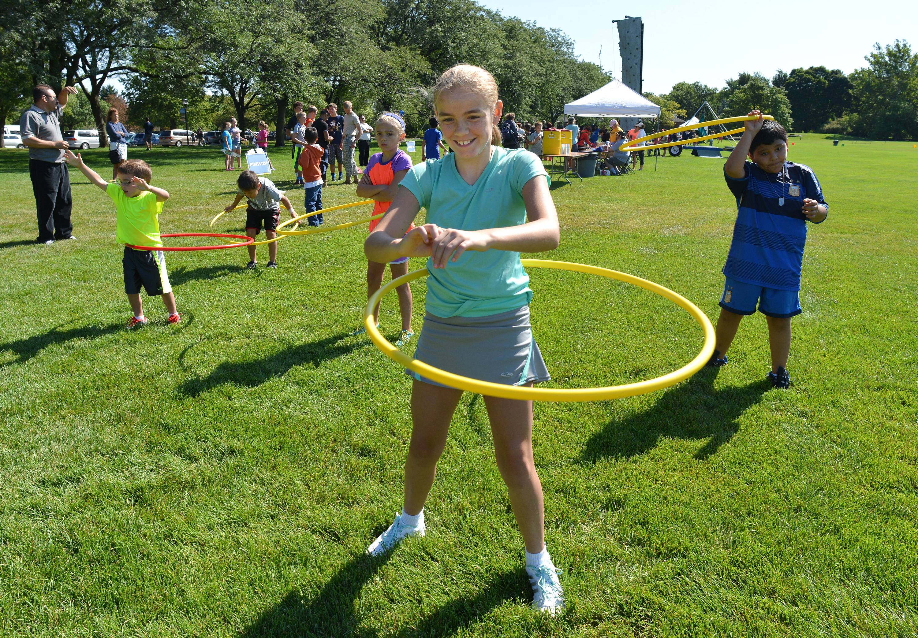 Kaitlyn Blaha, of Wheaton, was one of many kids who showed they could work hula hoops during Rep. Jeanne Ives' second annual Kids' Fitness and Health Boot Camp at Cantigny Park Friday.