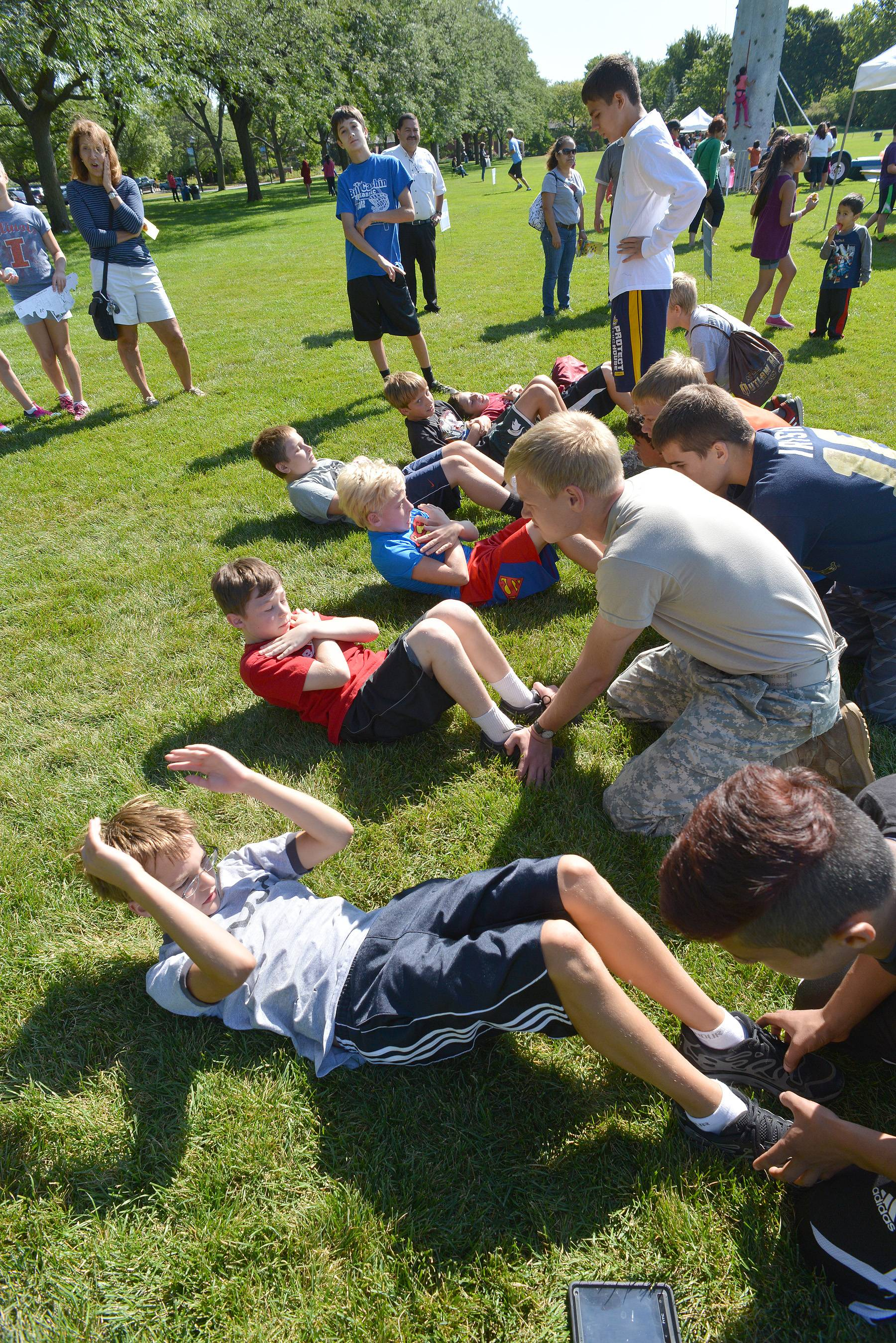 Participants went through more traditional boot camp exercises such as situps during Rep. Jeanne Ives' second annual Kids' Fitness and Health Boot Camp at Cantigny Park Friday.