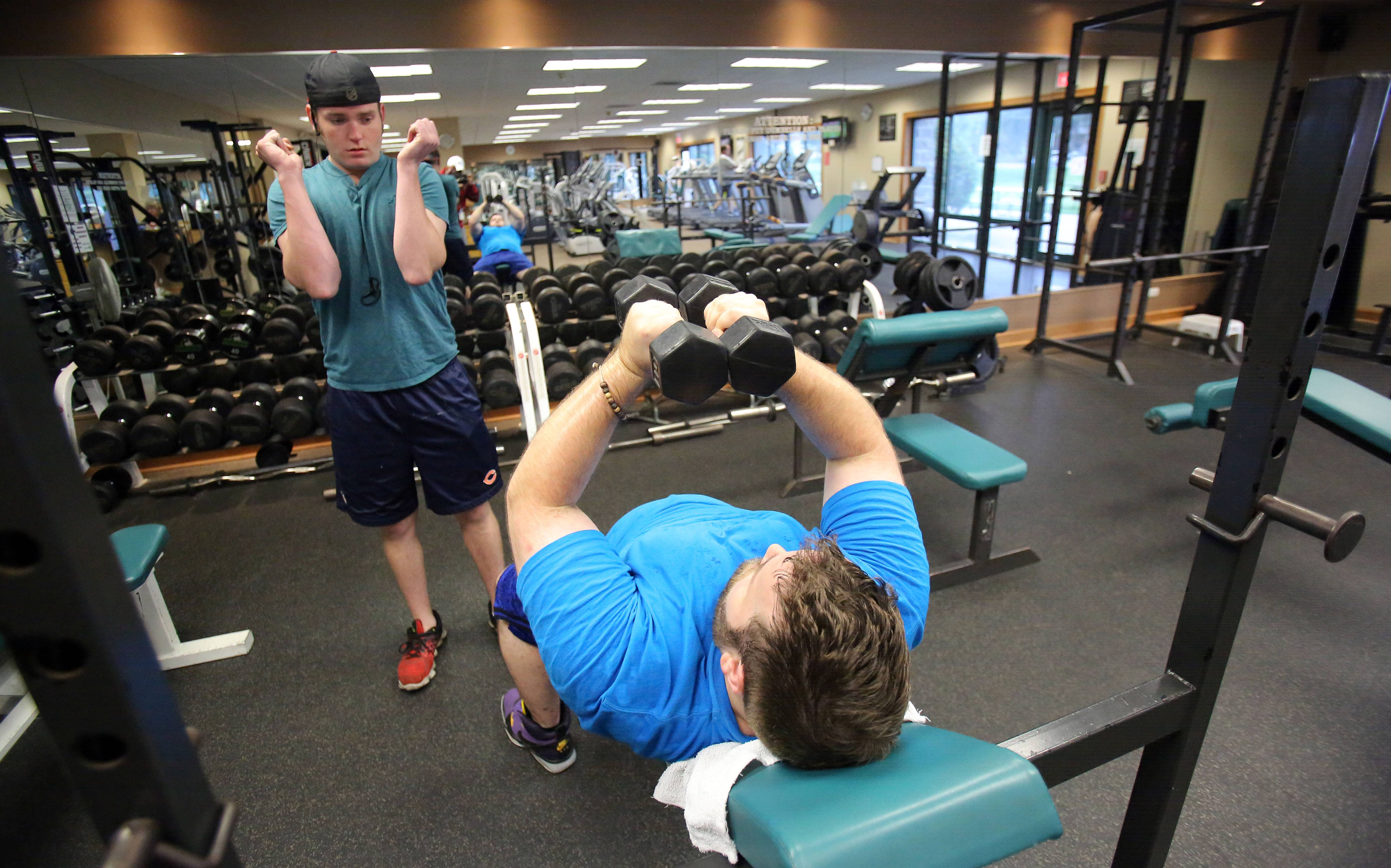 Ryan Shepherd, left, and Justin Johnsen, both of Wauconda, work out at the Wauconda Community Center Tuesday. An expansion of the center could create more fitness space.