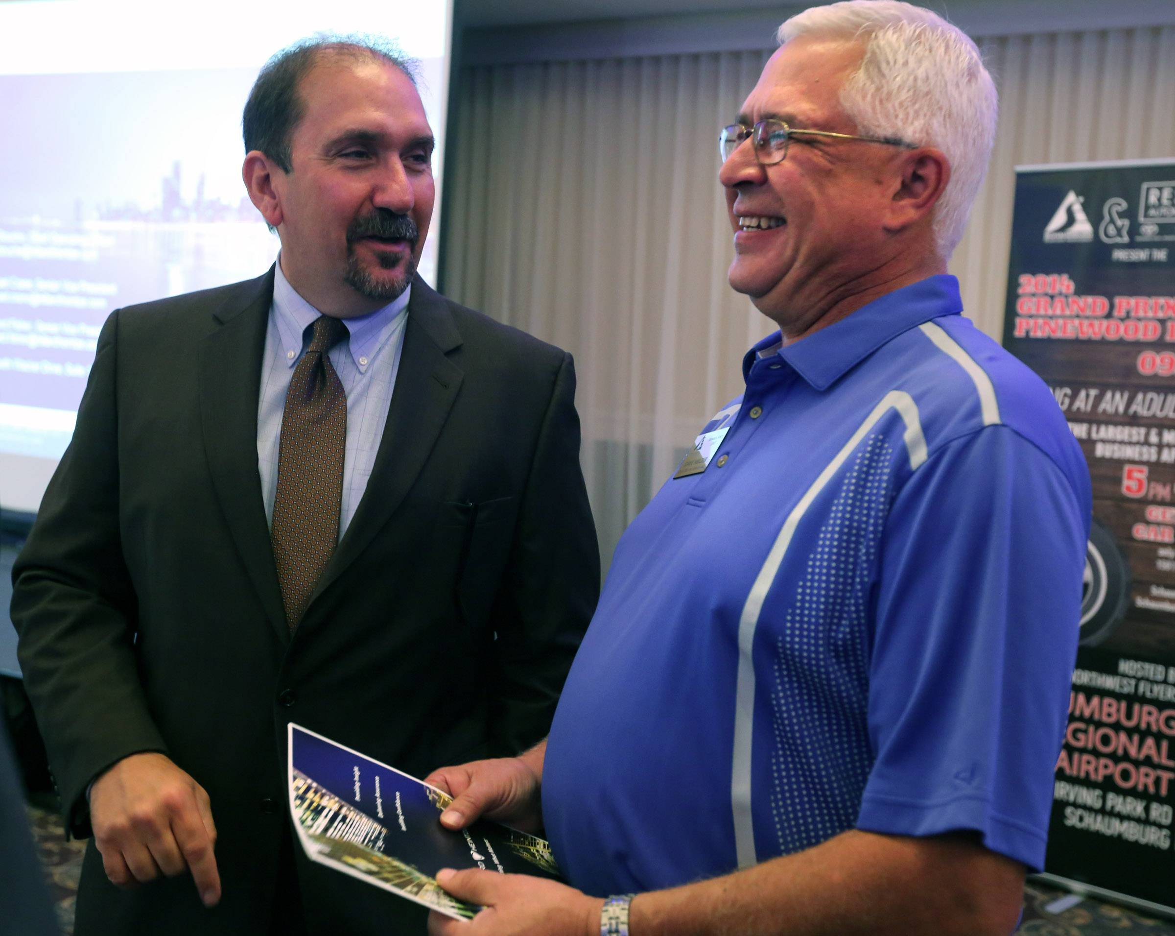 "Dave Melzer, sales and marketing manager at Quick Delivery Service Inc., right, talks with Ken Bouche, chief operating officer of Hillard Heintze, during the Schaumburg Business Association's ""Good Morning, Schaumburg"" breakfast Tuesday."