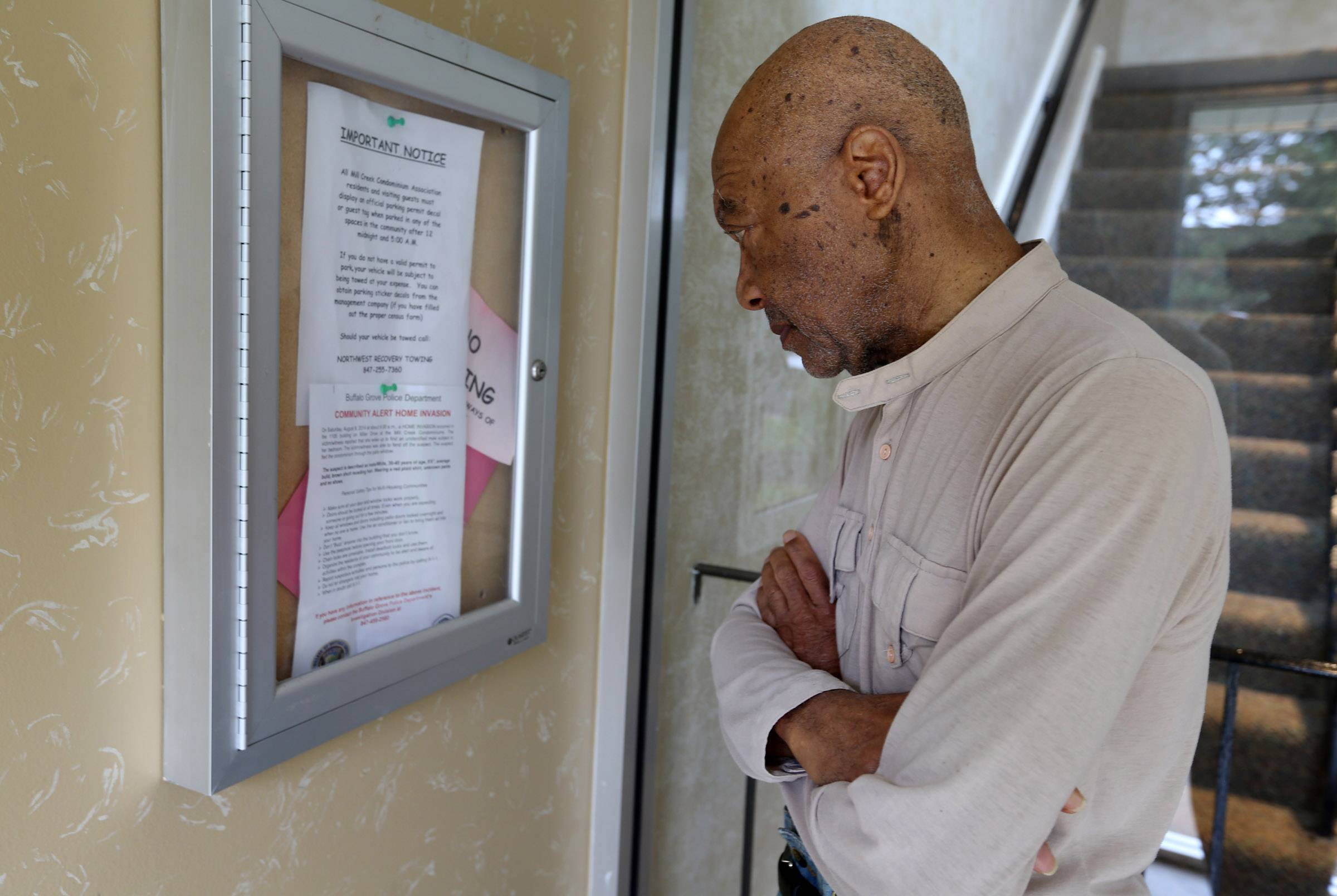 T. Edwards Plack reads a notice by Buffalo Grove police in a building at Mill Creek Condominiums in Buffalo Grove.
