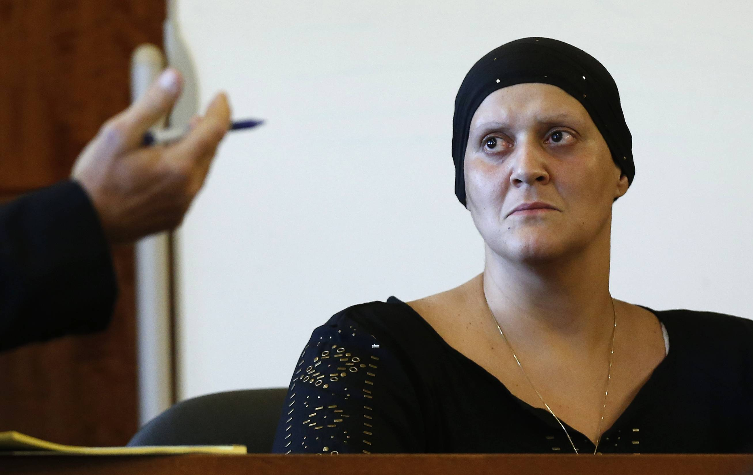 Tanya Singleton, a cousin of former New England Patriots football player Aaron Hernandez, pleaded guilty to criminal contempt in connection with the investigation of murder charges against Hernandez. She was spared jail time only because of her advanced cancer, a judge said Tuesday in sentencing her to two years of probation.