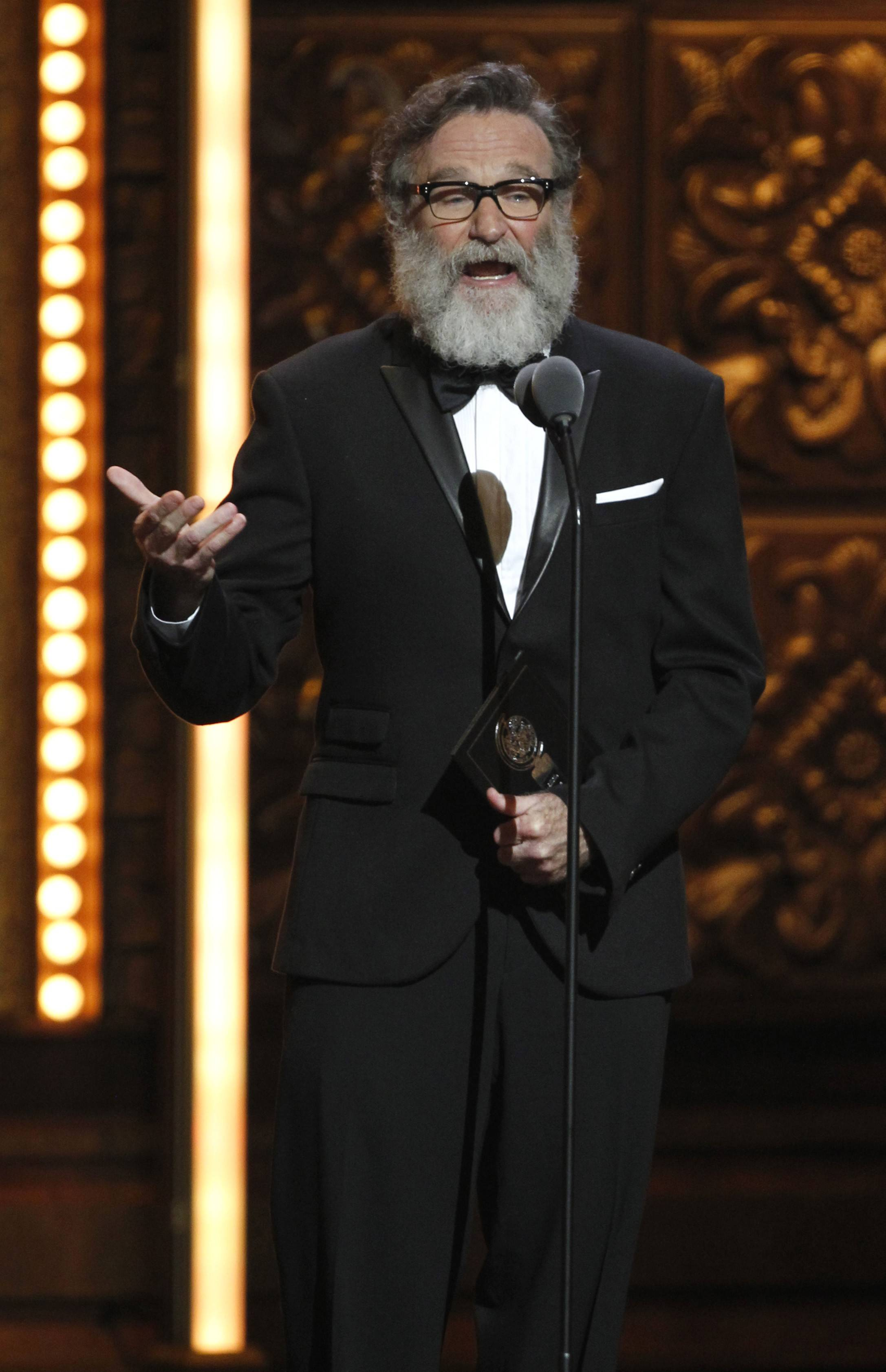 Robin Williams presents the award for Book of a Musical during the 65th annual Tony Awards in 2011.