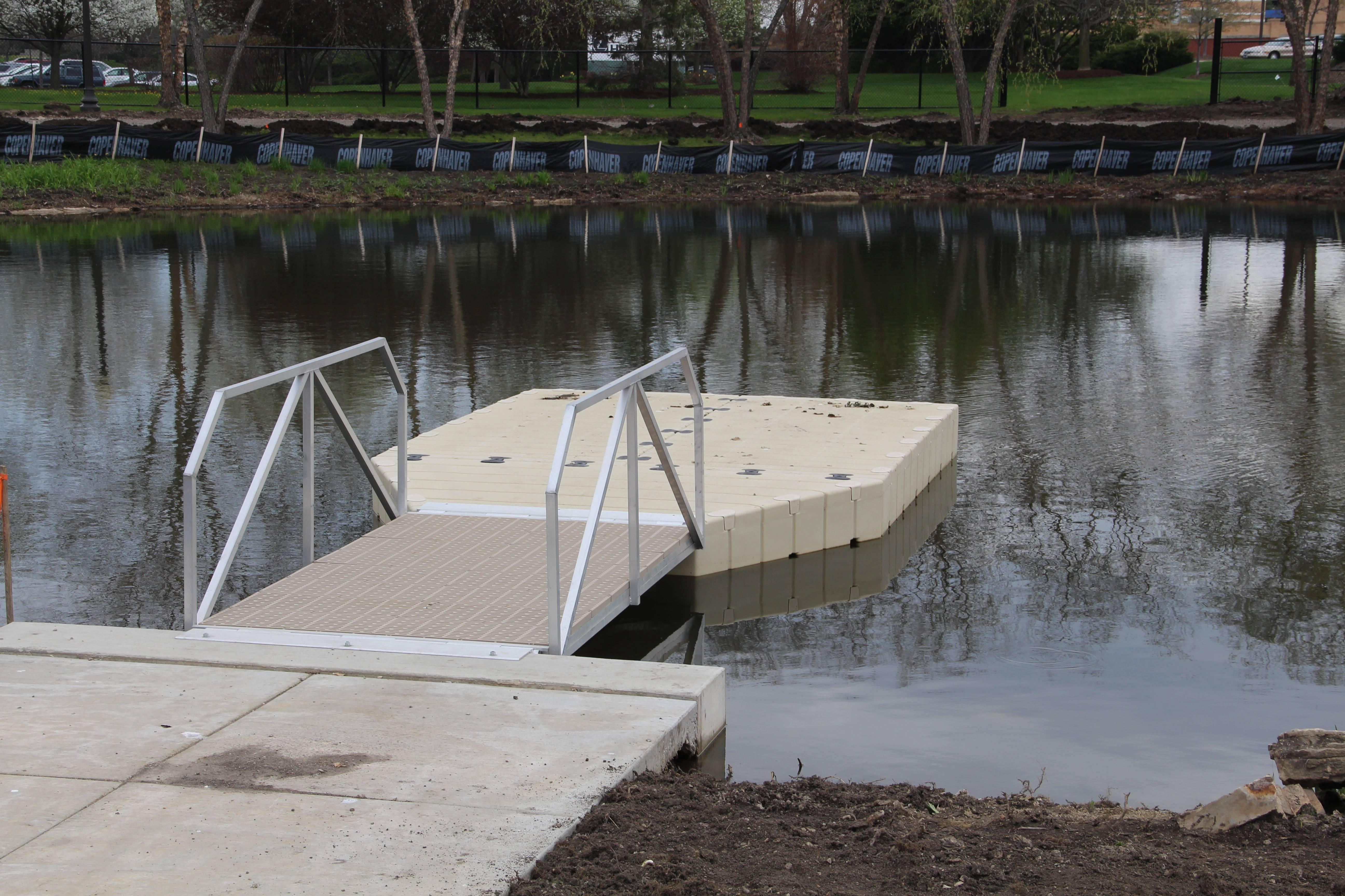 After they tire from running around Schaumburg's new 6.5-acre dog park, canines will be able to cool off with a swim in a pond that's among the facility's highlights. A special ramp leads to the pond, making it easy for dogs to get in and out of the water.