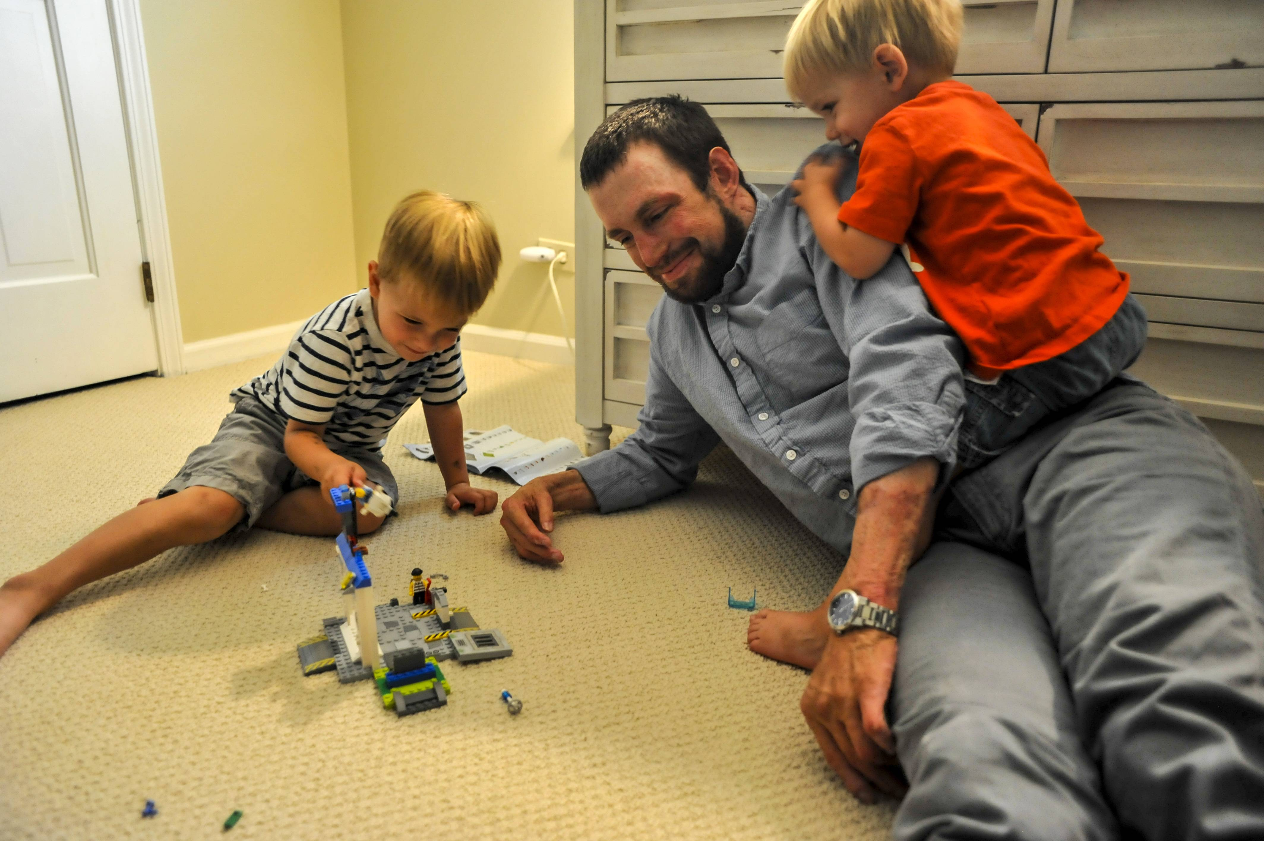 Hospitalized for four months after he was wounded by a roadside bomb in Afghanistan in 2012, retired Army Maj. Breg Hughes has recovered to the point where he can play with his children Brogan, 3, and Gavin, 2, in their Barrington home.