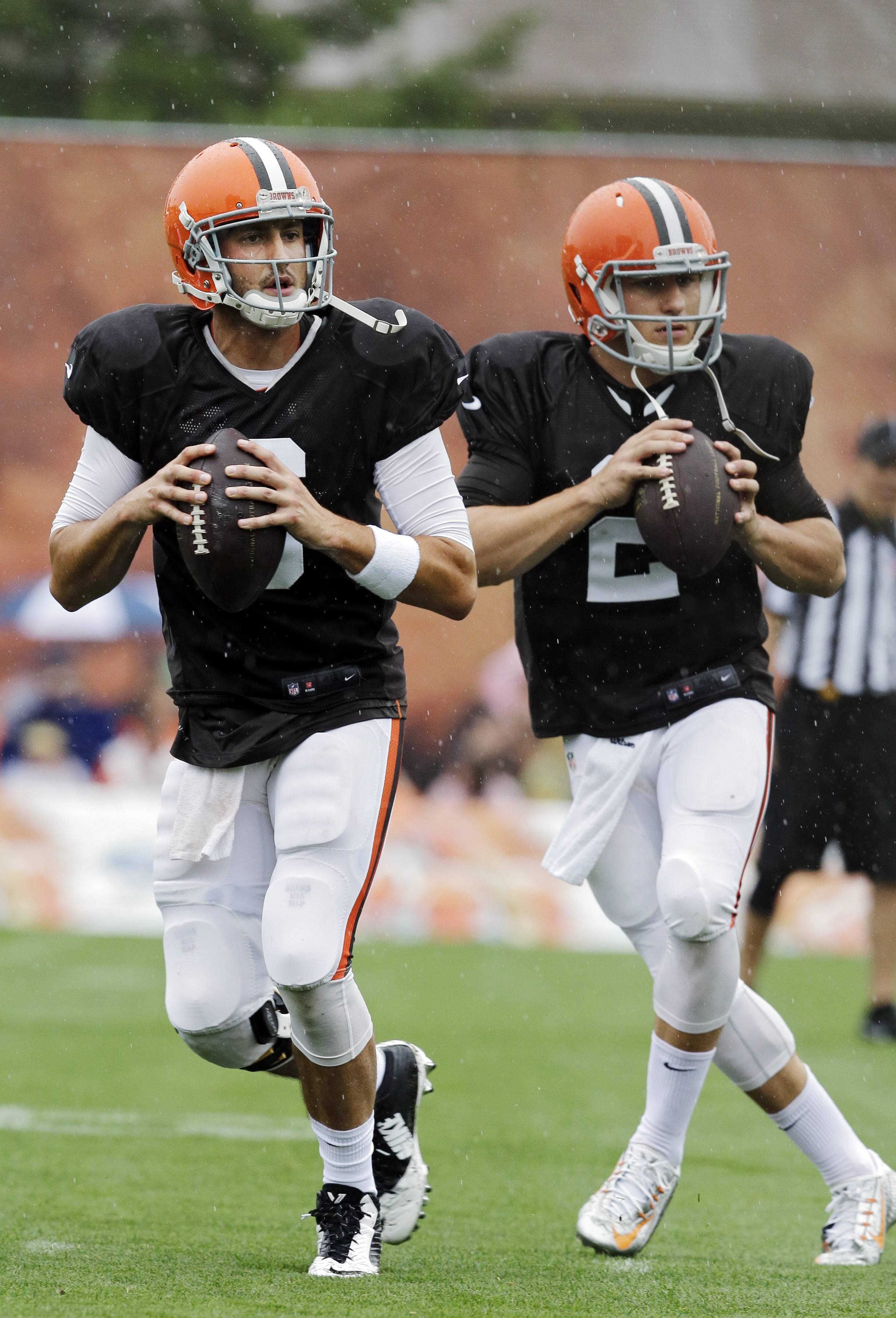 Cleveland Browns quarterbacks Brian Hoyer, left, and rookie Johnny Manziel are locked in a preseason battle to win the starting job.