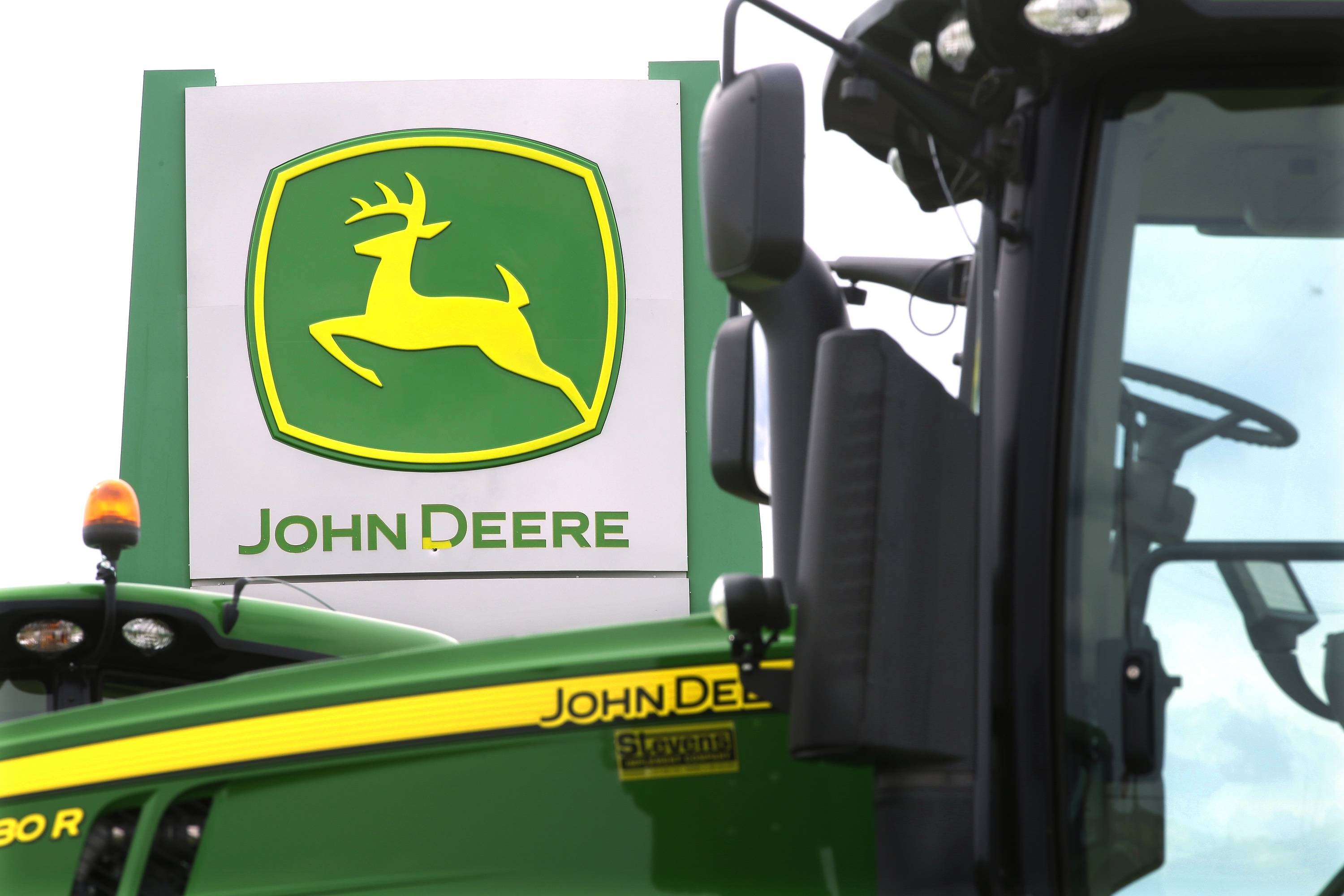 Deere's third-quarter profit fell 15 percent and the farming equipment maker thinks the same weak sales in the U.S., Canada and abroad will cut into earnings for the year.