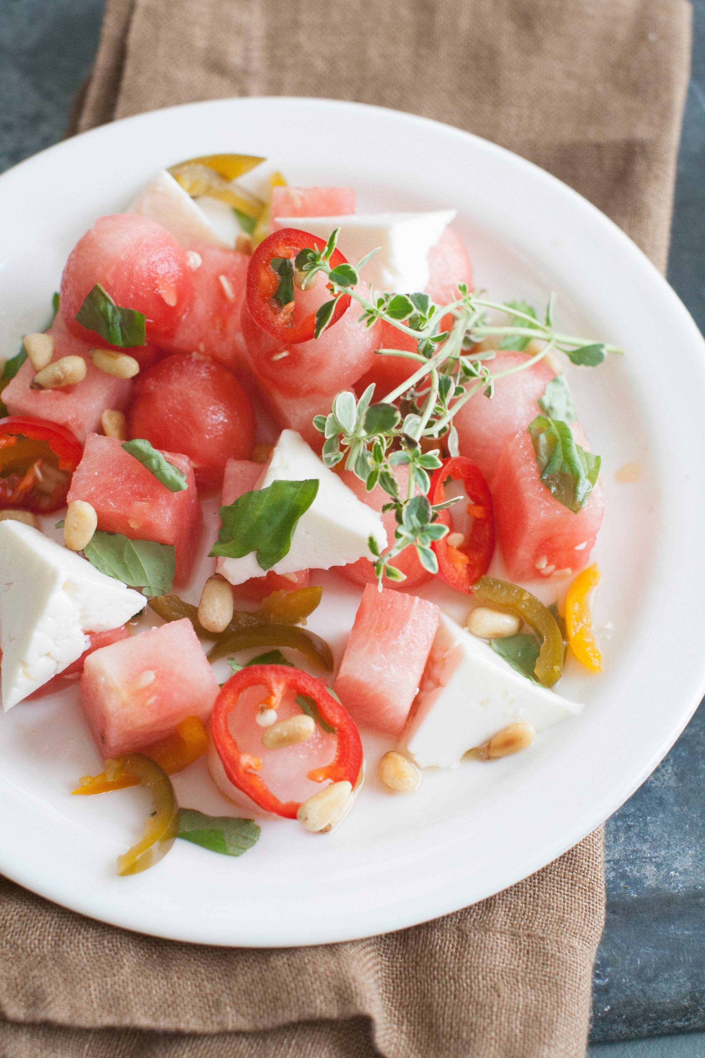 Watermelon can handle a bit of spicy and partners well with feta and basil for a refreshing salad.