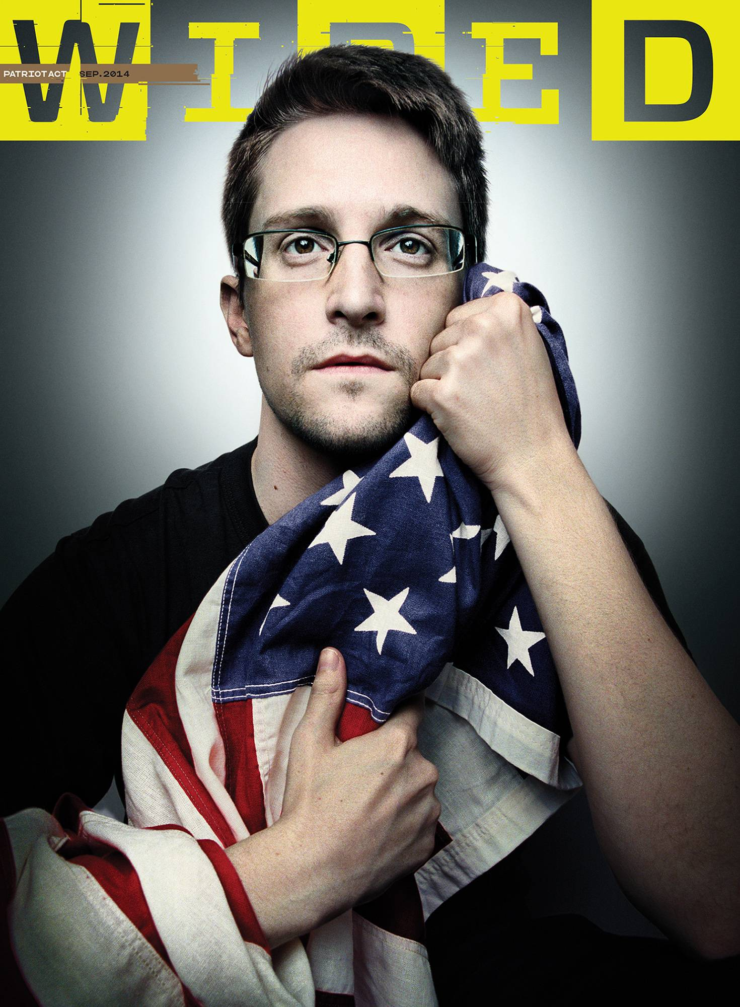 This image provided by Platon/Wired shows the cover of the September 2014 issue of Wired magazine, featuring former National Security Agency contractor Edward Snowden. Snowden gave an exclusive interview with Wired, in the issue scheduled to hit newsstands on Aug. 26.