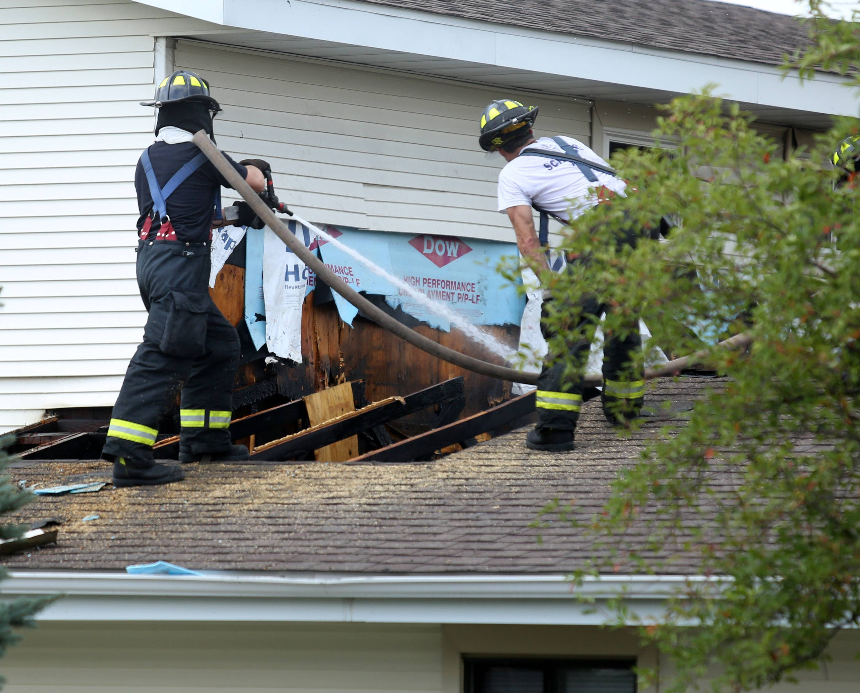 Schaumburg firefighters extinguish a house fire on the 900 block of Walpole Lane on Wednesday in Schaumburg.