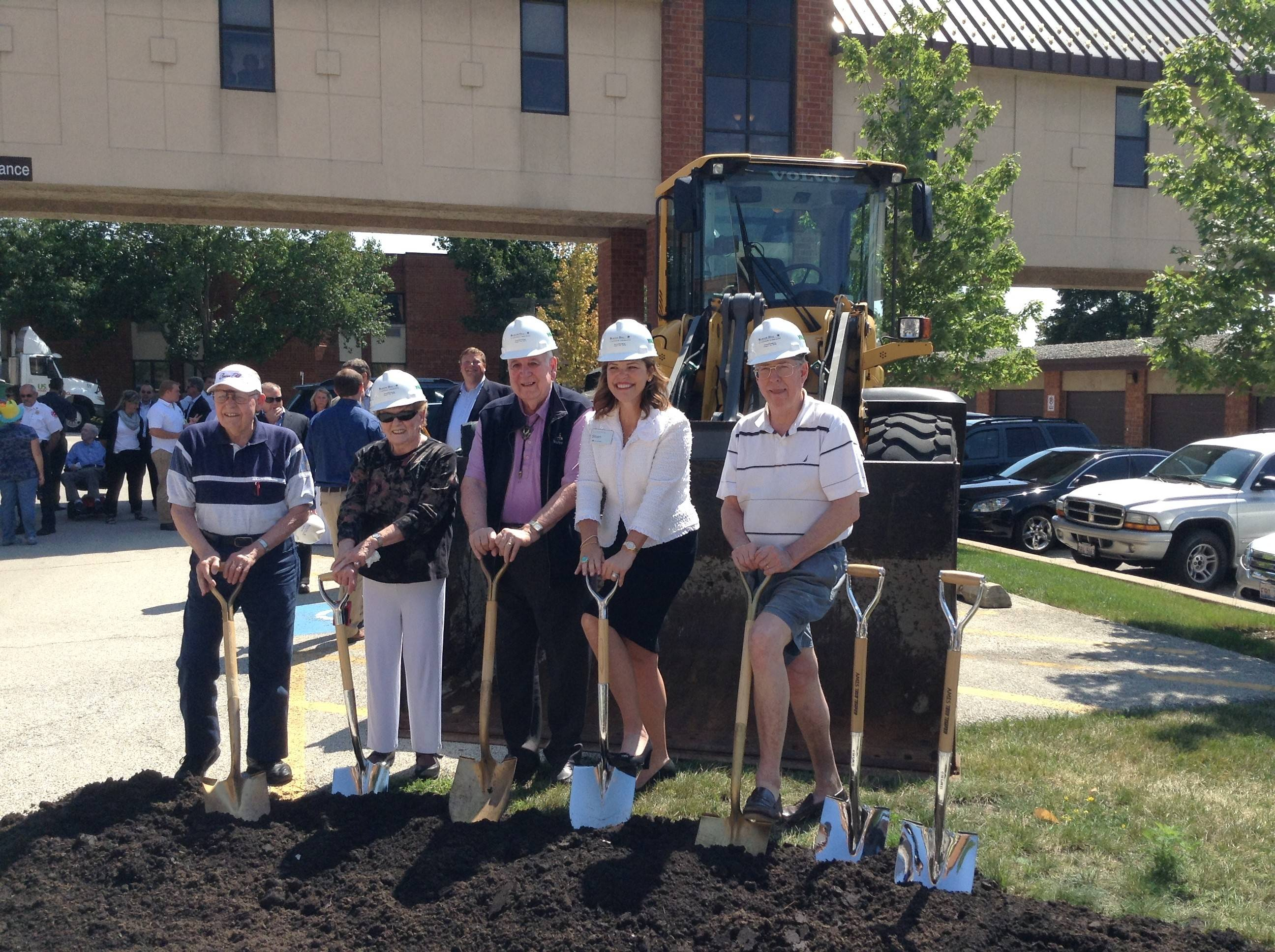 Sloan Bentley, second from right, president and chief executive officer of Lifespace Communities, and some residents take part in a groundbreaking ceremony Wednesday for a $15 million expansion at Beacon Hill senior living community in Lombard.
