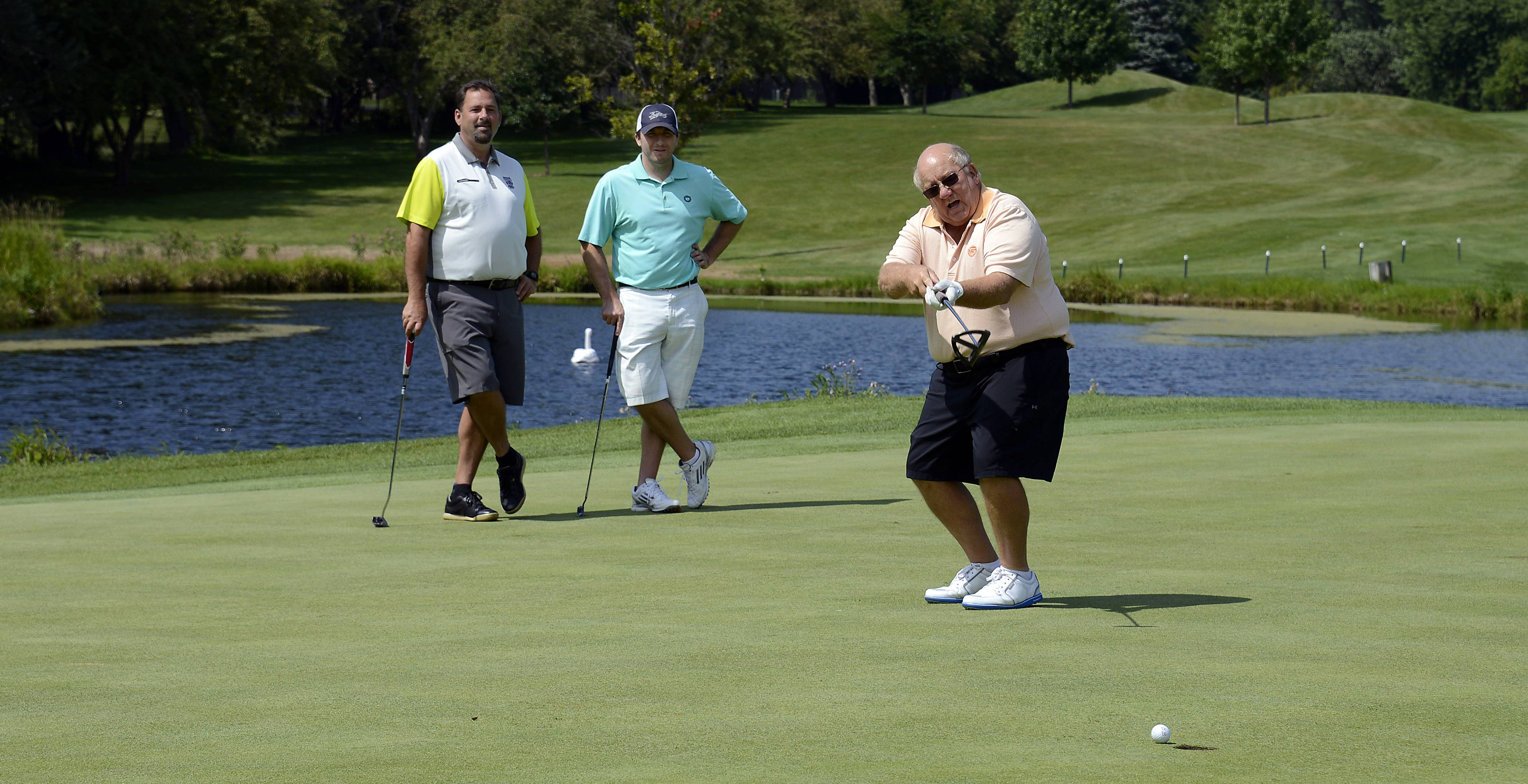 Brian Burke, president and CEO of LinksTechnology Inc. of Schaumburg, reacts as his ball heads toward the second hole but falls short. Roy Picciuca of Wintrust Bank in Des Plaines and Mike Radek of Max Packaging Inc. of Mokena wait their turn.