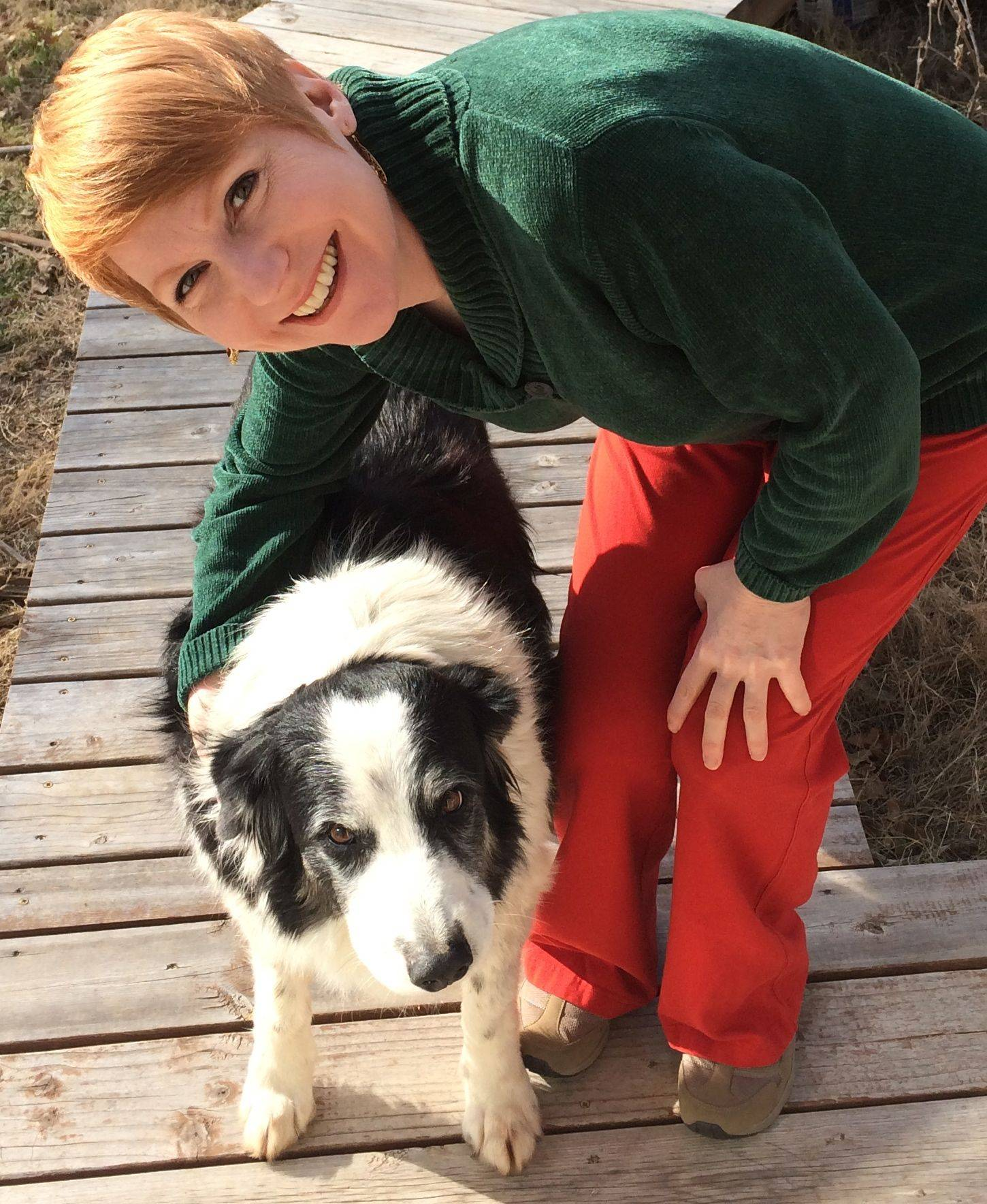 Emotion researcher Christine Harris, a professor of psychology at the University of California-San Diego, poses with her border collie in San Diego.