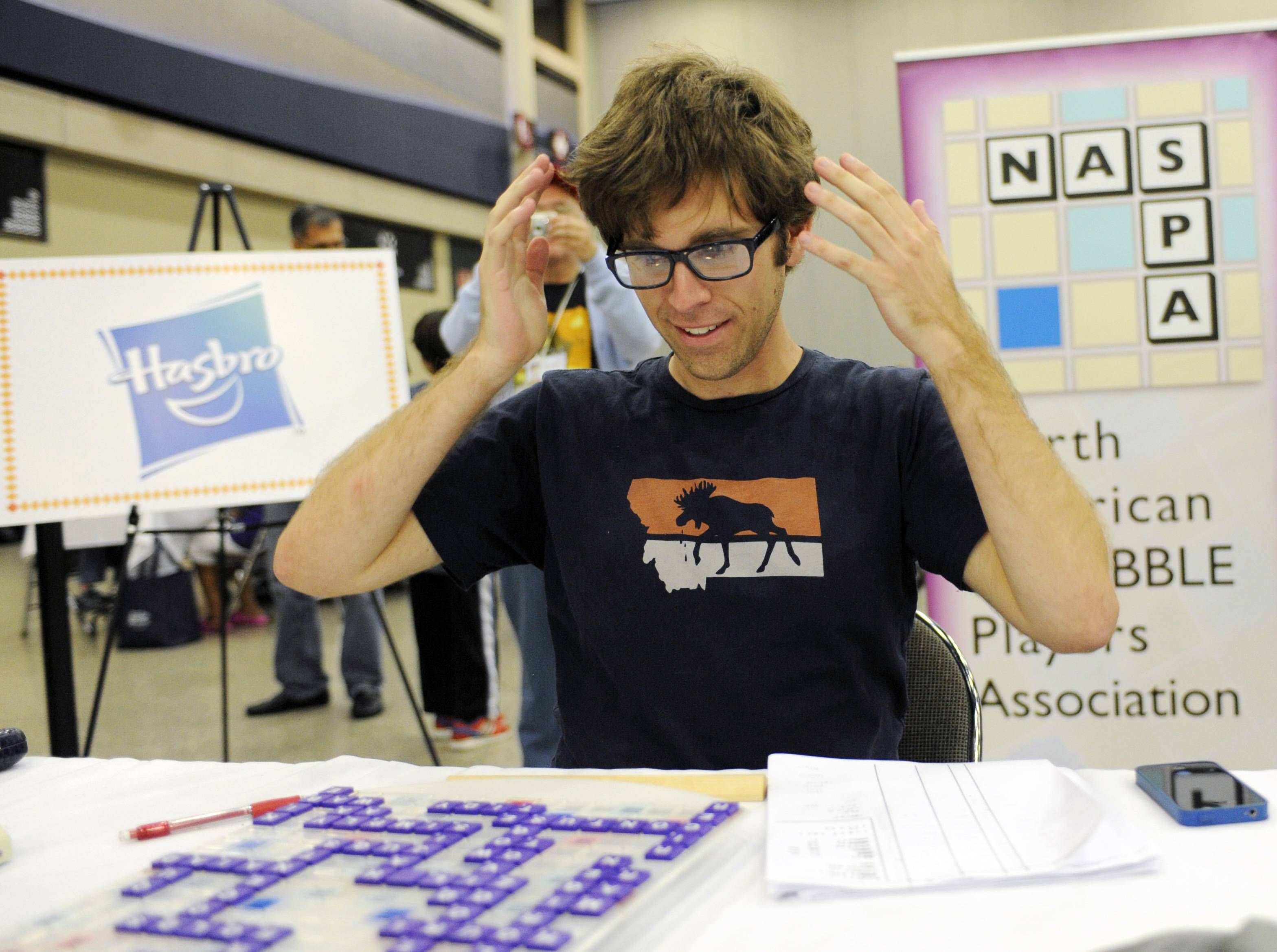 Conrad Bassett-Bouchard reacts after he won the title at the National Scrabble Championships Wednesday in Buffalo, N.Y. He led for most of the match, outscoring his opponent 477-350.