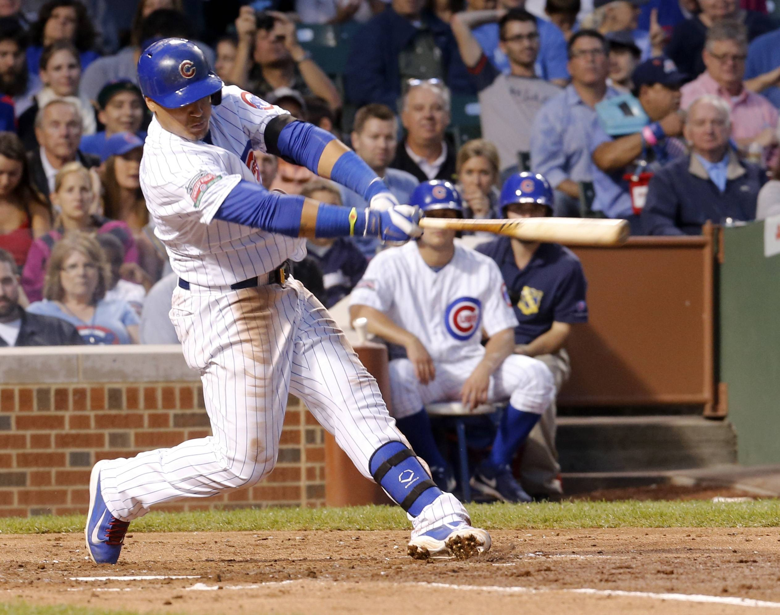 Chicago Cubs' Javier Baez follows through on a home run off Milwaukee Brewers starting pitcher Kyle Lohse during the third inning Wednesday at Wrigley Field. The Cubs won 4-2.