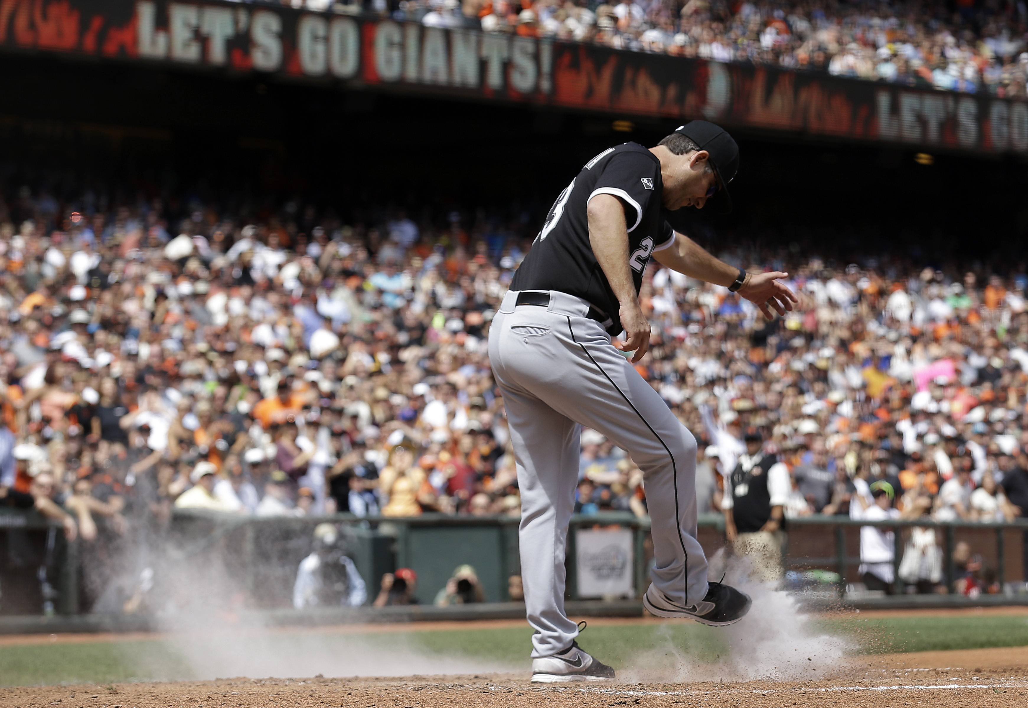White Sox manager Robin Ventura kicks dirt over the plate Wednesday after being ejected for arguing a call on San Francisco Giants' Gregor Blanco, who was originally ruled out at home but then ruled safe after review, during the seventh inning in San Francisco.