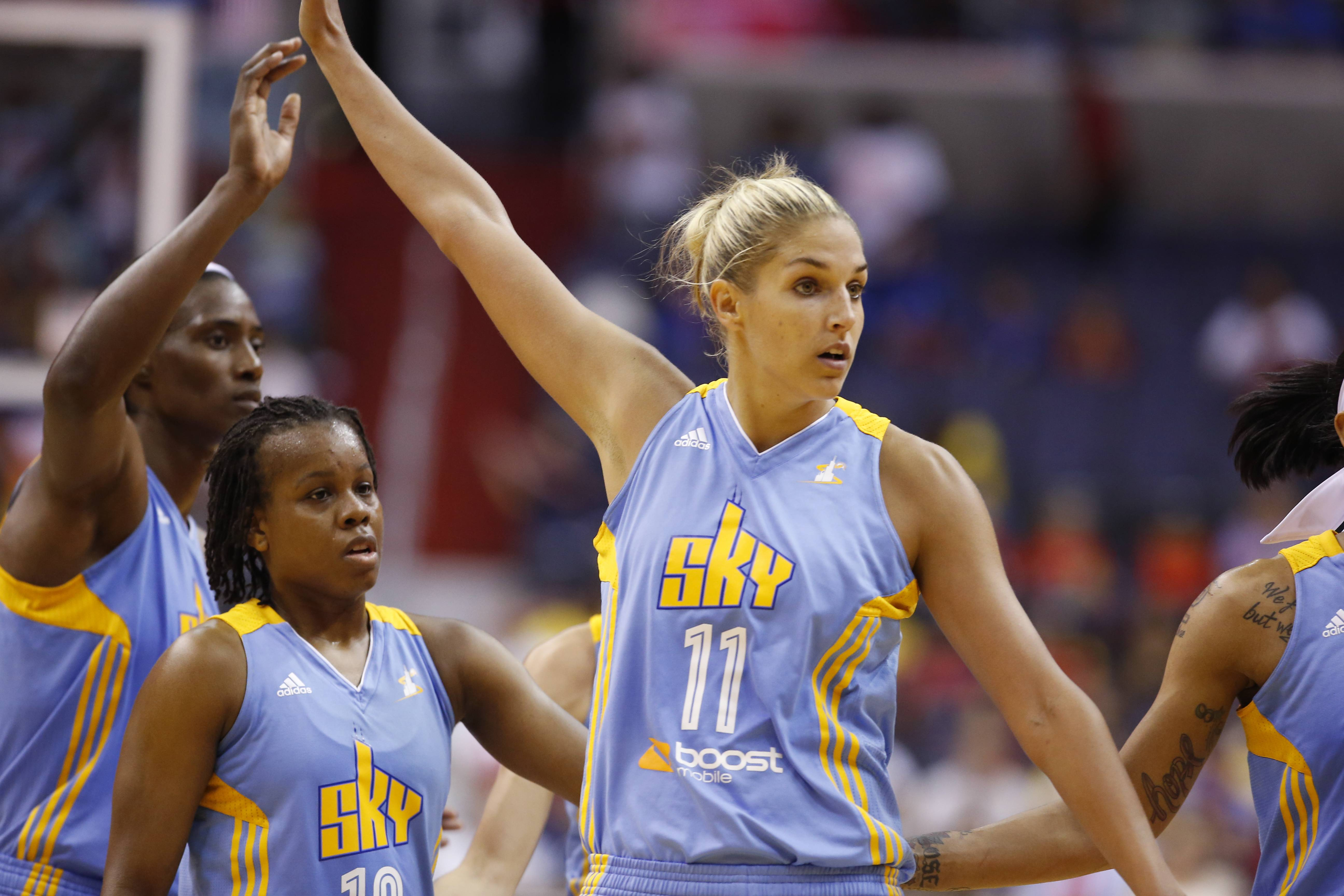 Sky center Sylvia Fowles (34), and guard/forward Elena Delle Donne (11), celebrate over guard Epiphanny Prince (10), as they come off the court for a timeout during Wednesday's game against the Washington Mystics Wednesday, Aug. 13, 2014 in Washington. The Sky won 72-69.
