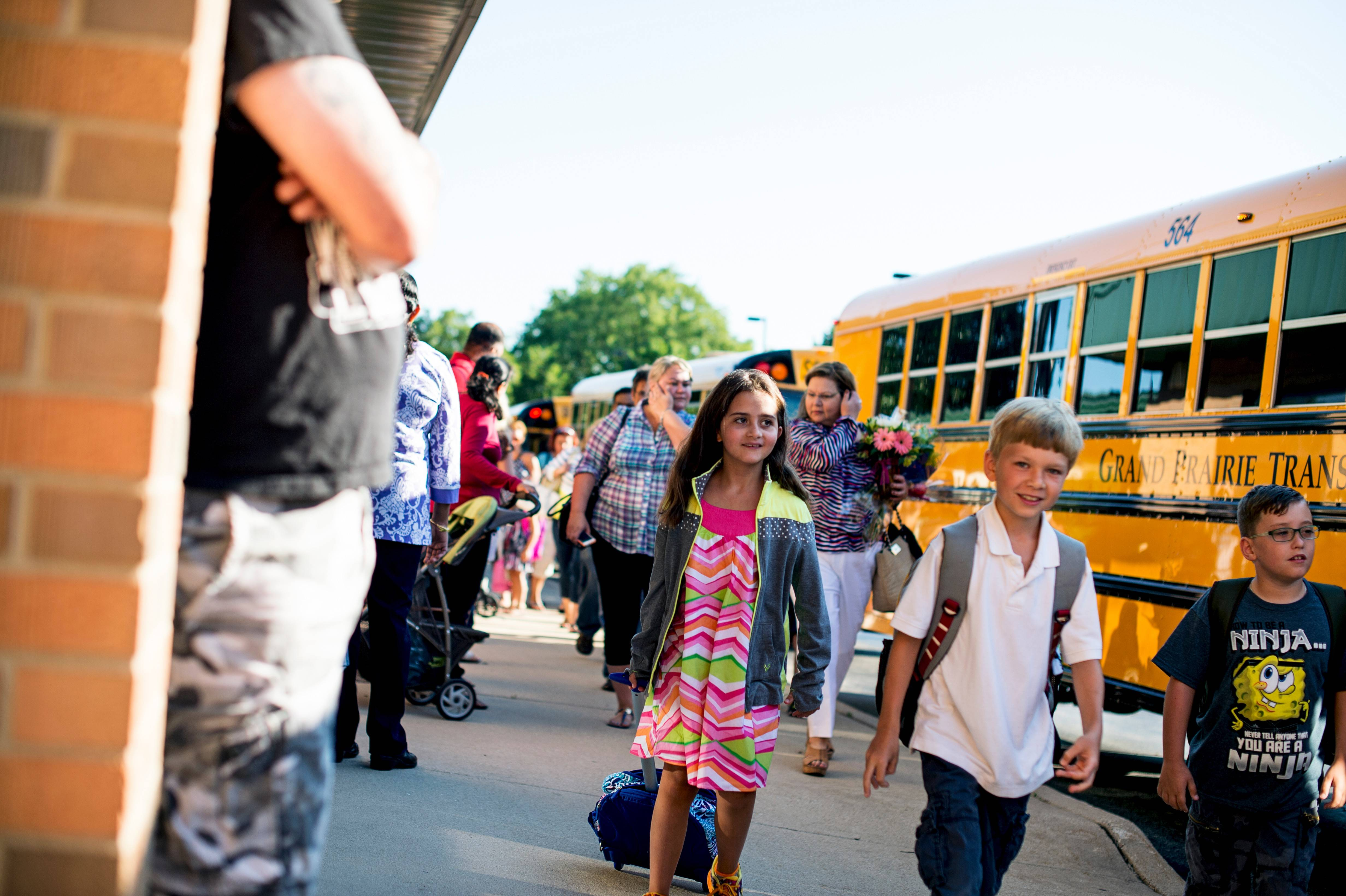 Students enter Ridge Family Center for Learning on the school's first day back in session recently after a break.