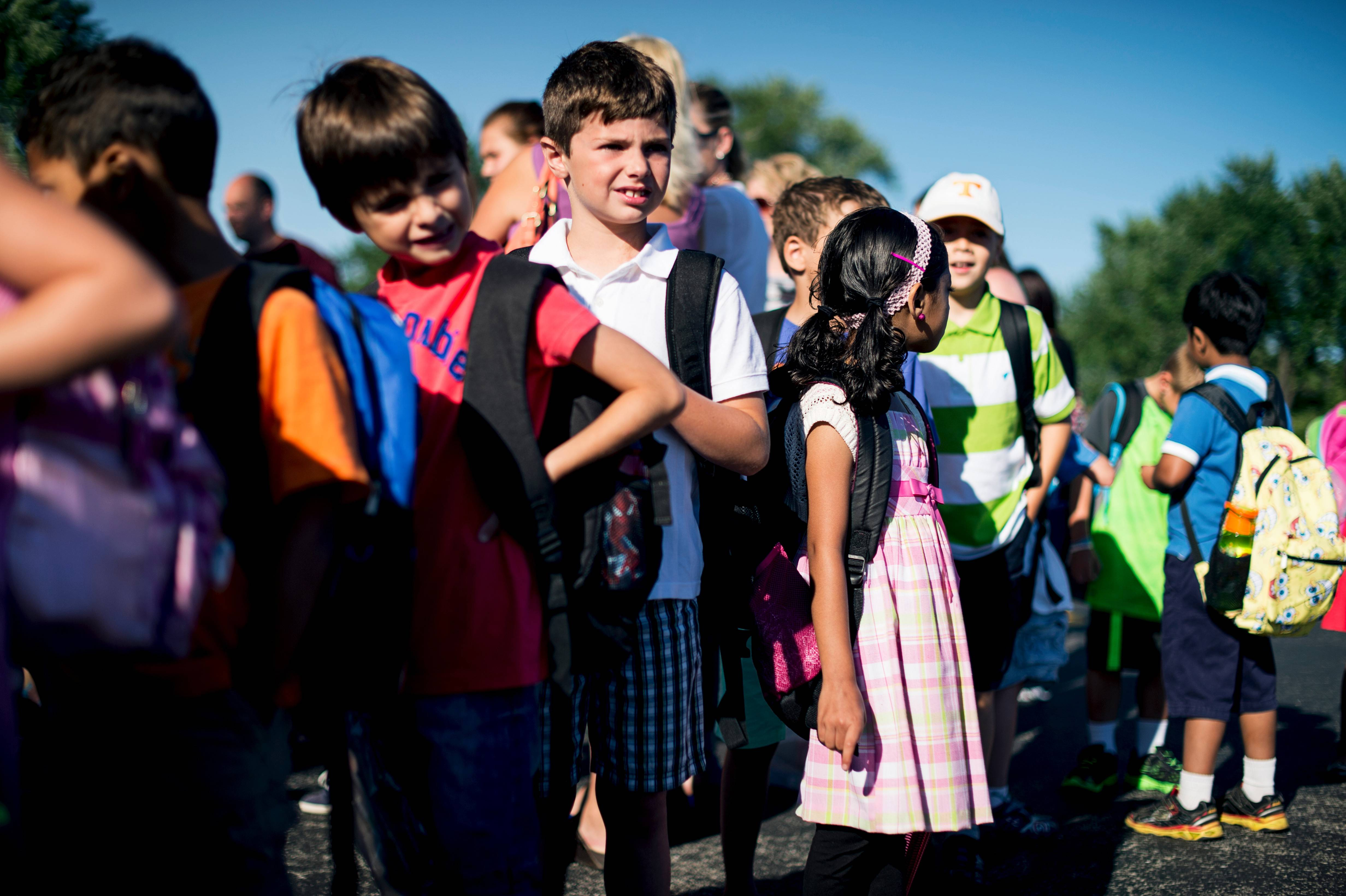 Students line up on the first day back in school at Ridge Family Center for Learning in Elk Grove Village.