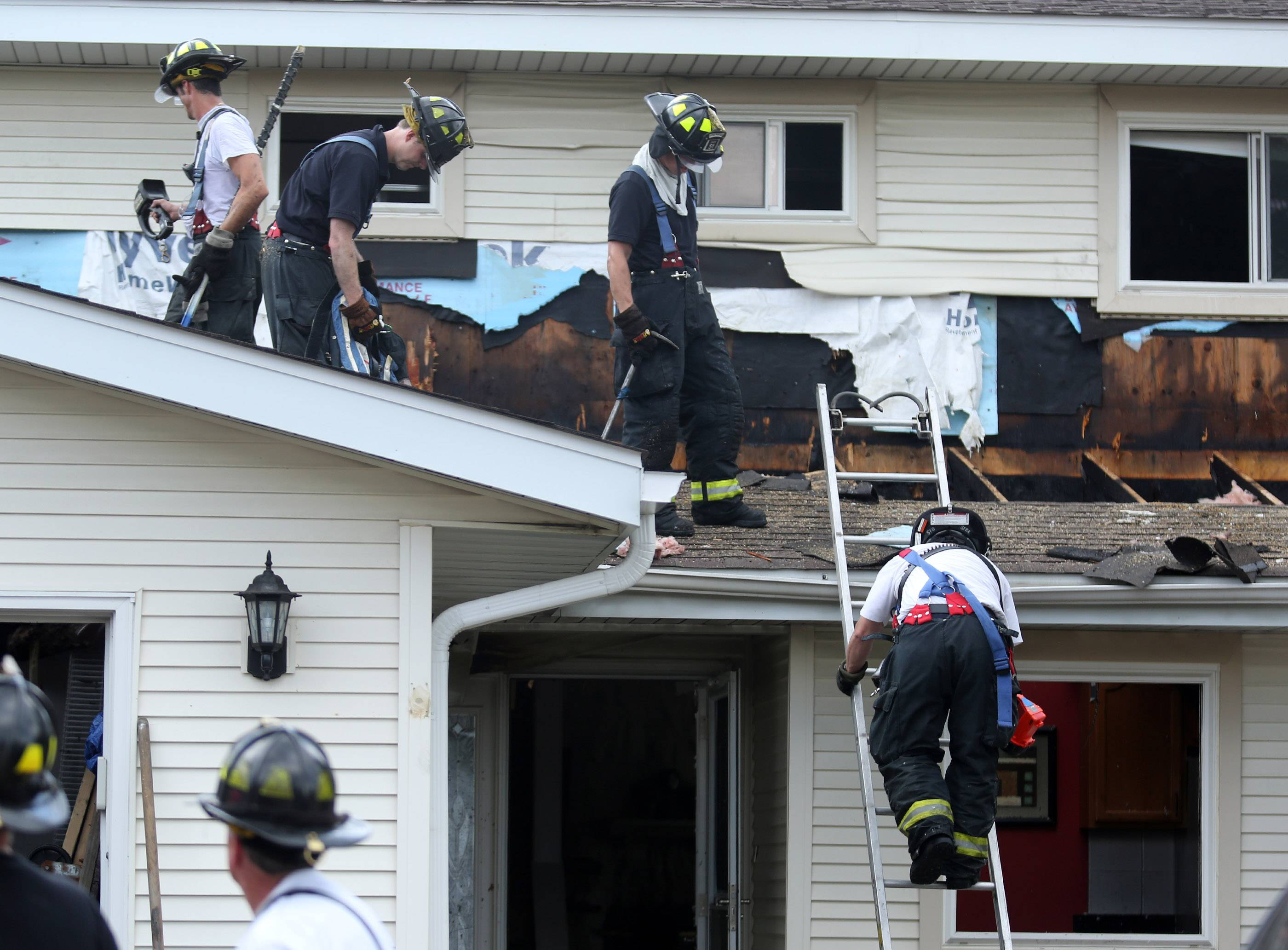 Schaumburg firefighters at the scene of a house fire on the 900 block of Walpole Lane on Wednesday in Schaumburg.