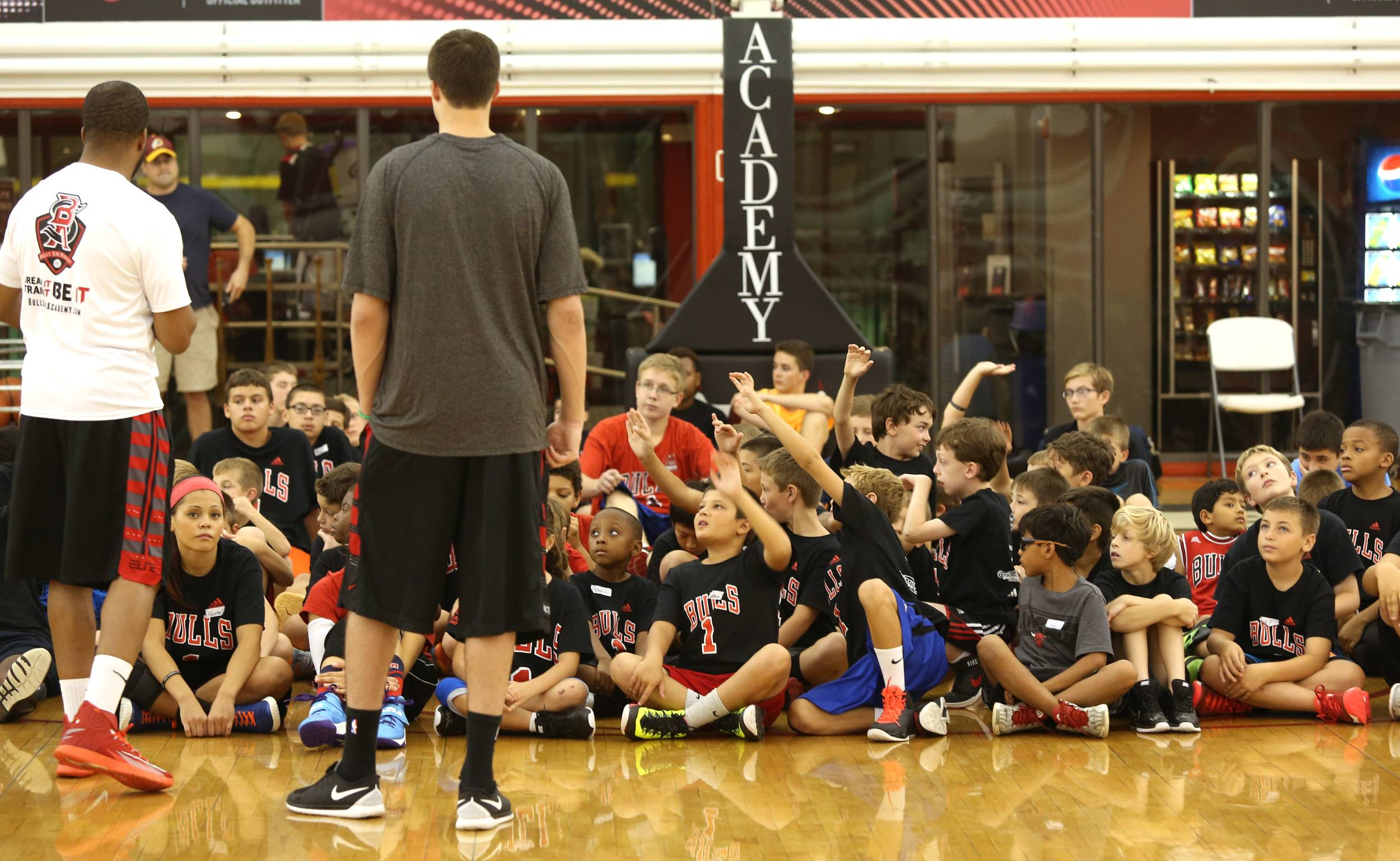 Basketball campers compete for the chance to ask Bulls forward Doug McDermott a question Wednesday during the rookie's first visit to Bulls/Sox Academy in Lisle.