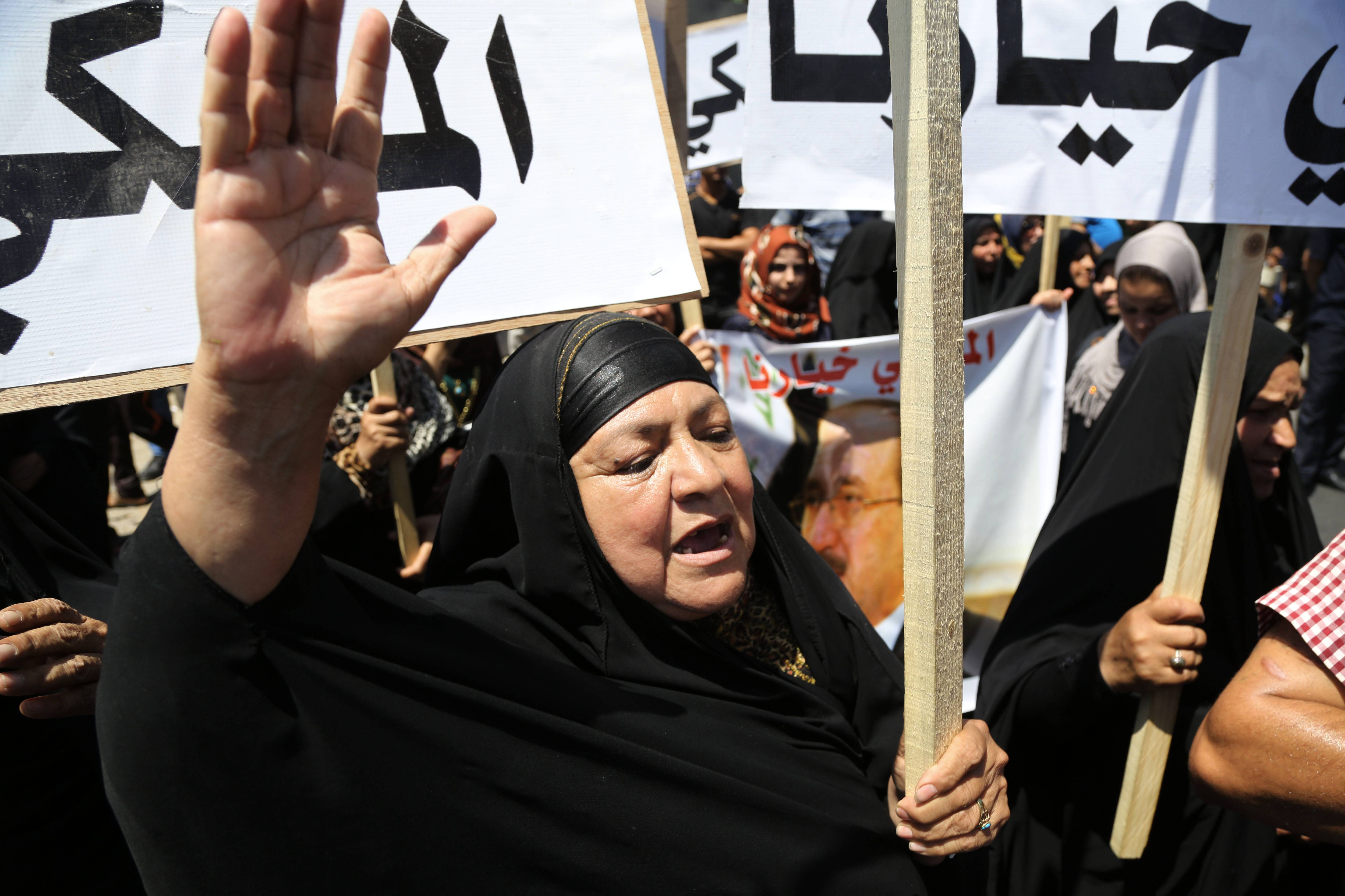 A supporter of Prime Minister Nouri al-Maliki chants slogans during a demonstration in Baghdad, Iraq, Wednesday, Aug 13, 2014. Tanks and Humvees were positioned on Baghdad bridges and at major intersections on Wednesday, with security personnel more visible than usual as pro-Maliki demonstrators took to Firdous Square in the capital, pledging their allegiance to him.
