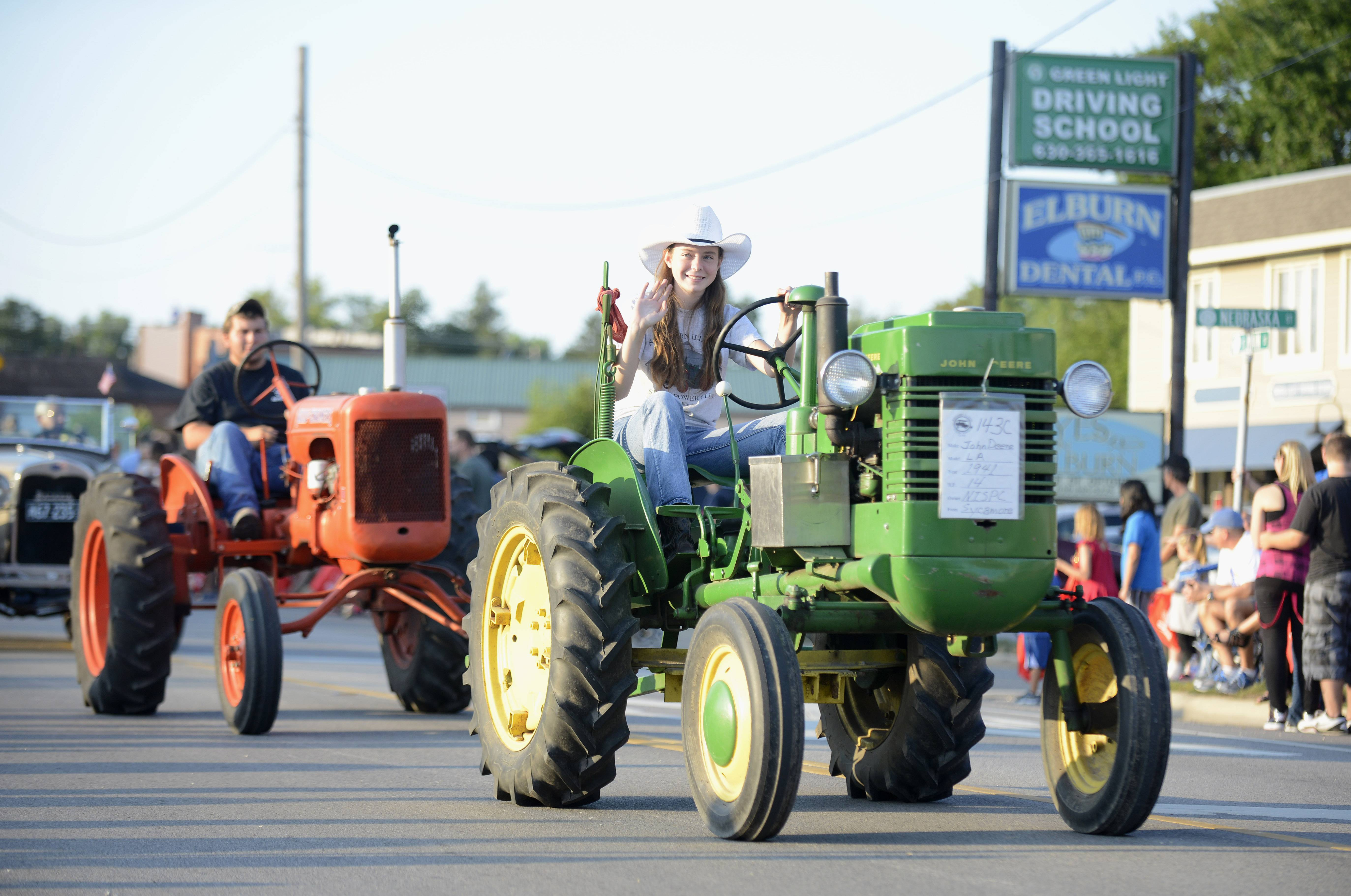 Jennifer Stevens, 14, of Sycamore rides a 1941 John Deere tractor in the Elburn Days parade. Stevens said she has been driving tractors since she was three, when her father made one just for her size.